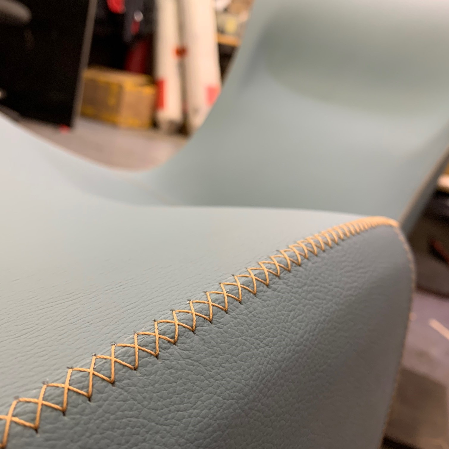 Stichting detail on the Bodice Rocker leather lounge chair.
