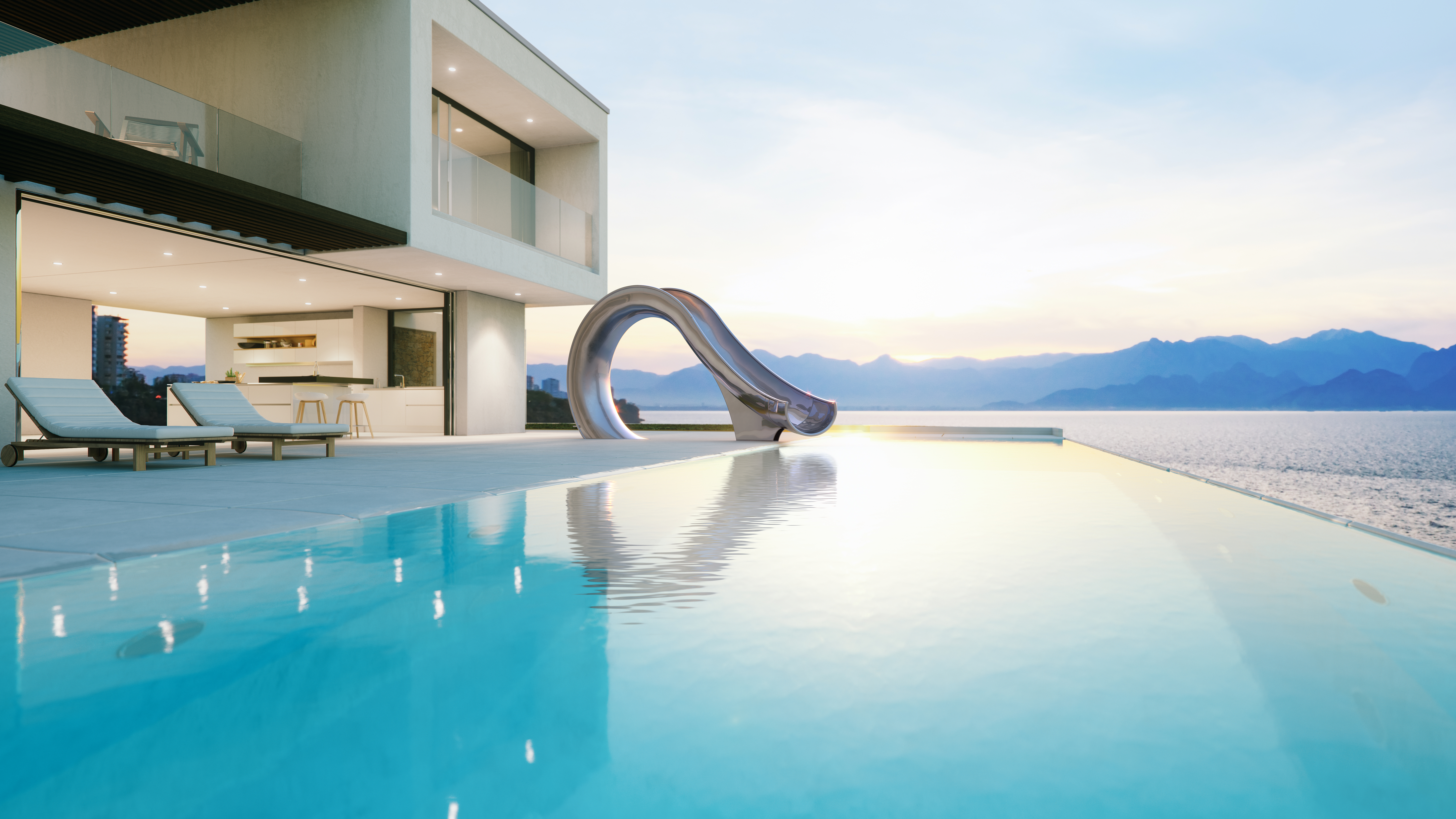 Pool side sculptural water slide next to modern house at sunset