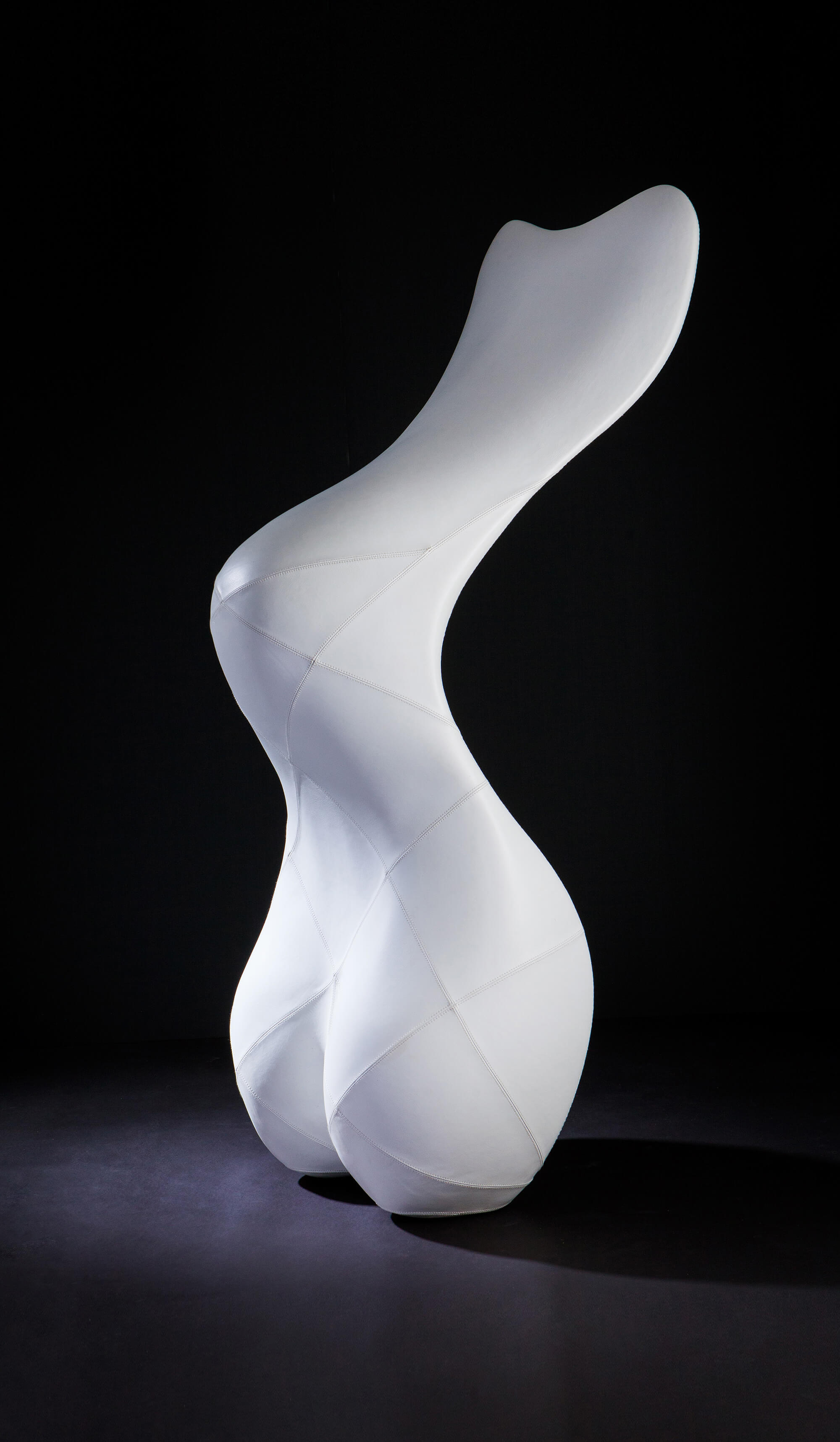 Custom made sculptural chair in white leather by Splinterworks.