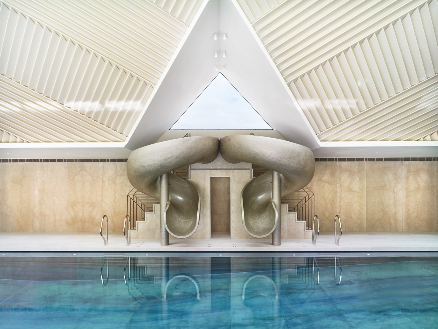 Double pool slide by Splinterworks in spectacularly designed pool pavilion.