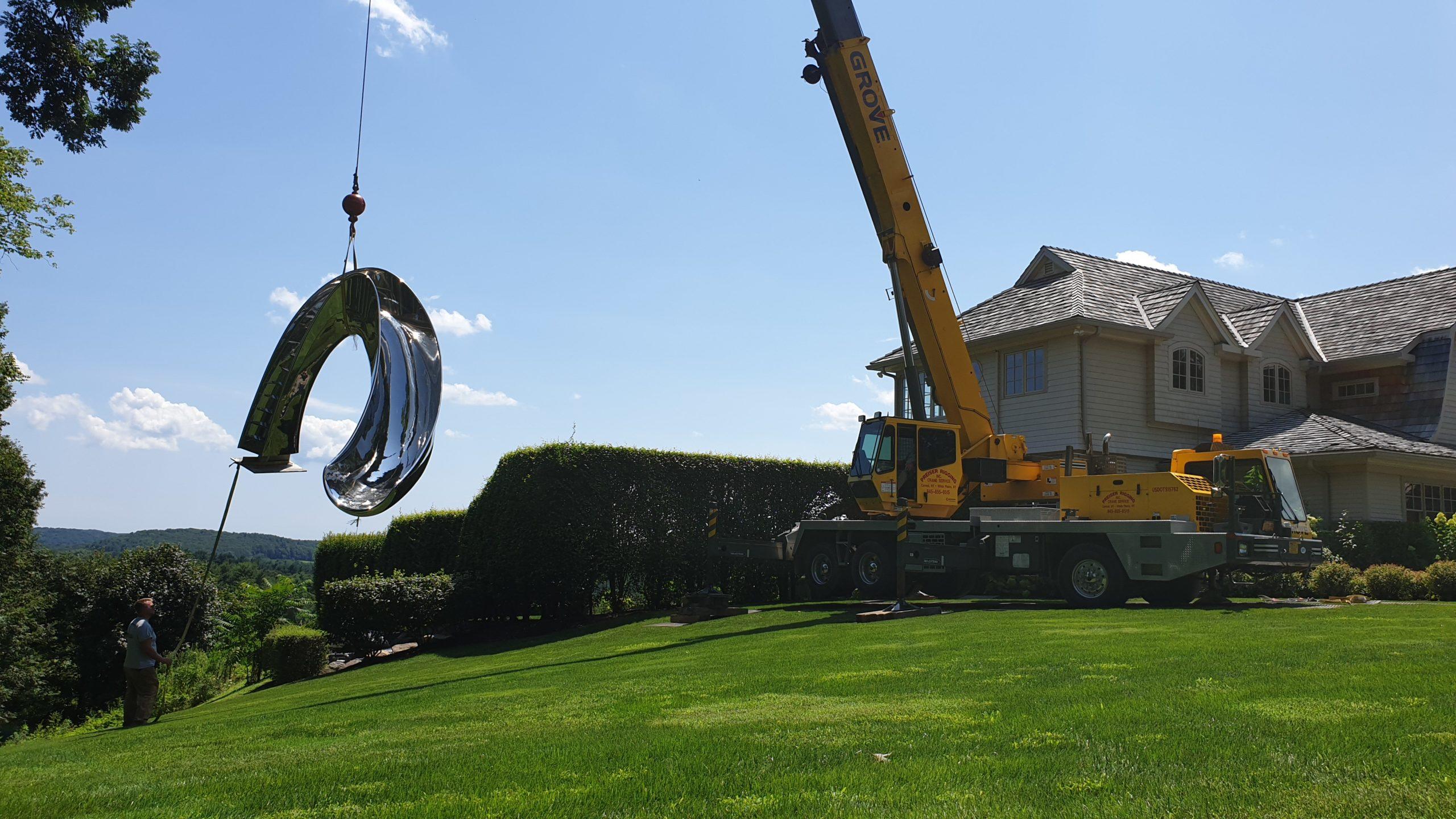 Craning in huge sculptural pool slide for outdoor pool