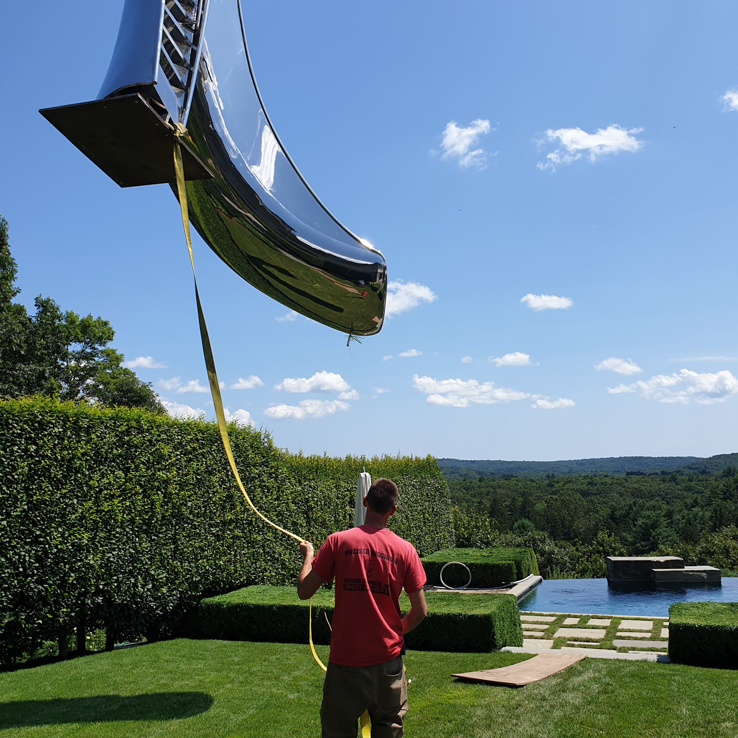 Installation of swimming pool slide for outdoor pool