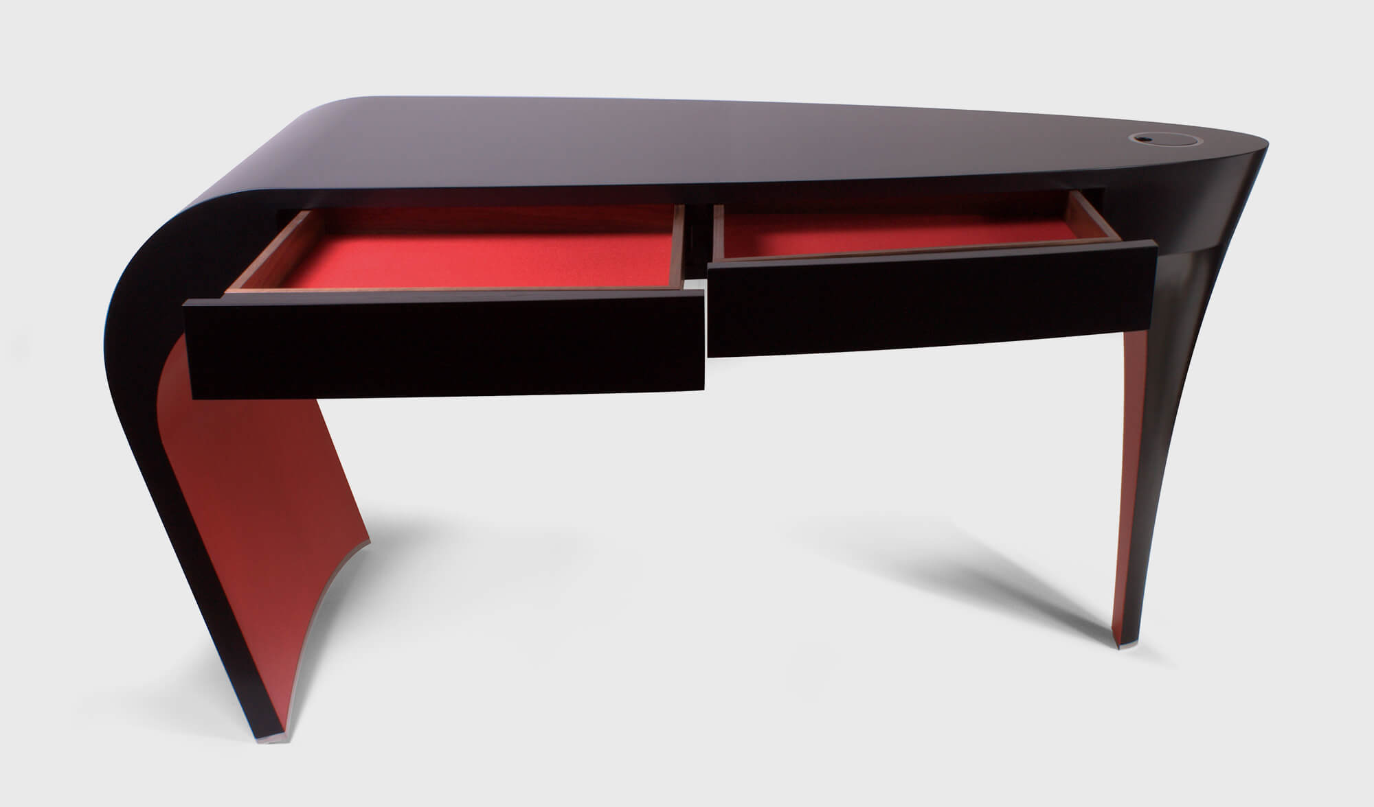 Black lacquer dressing table with red detail is an heirloom of the future.