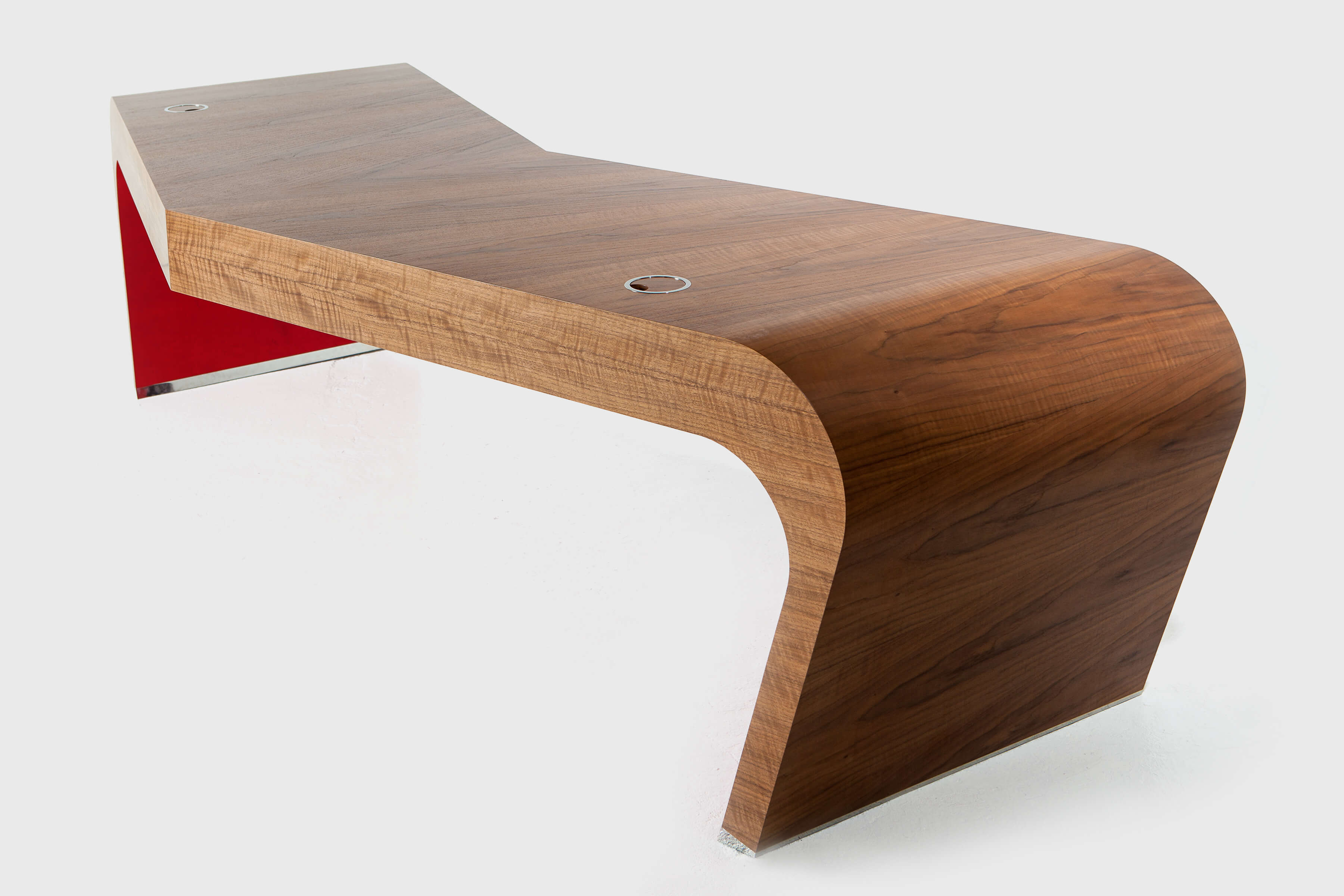 Large v-shaped desk with dramatic red detail hand-crafted by Splinterworks