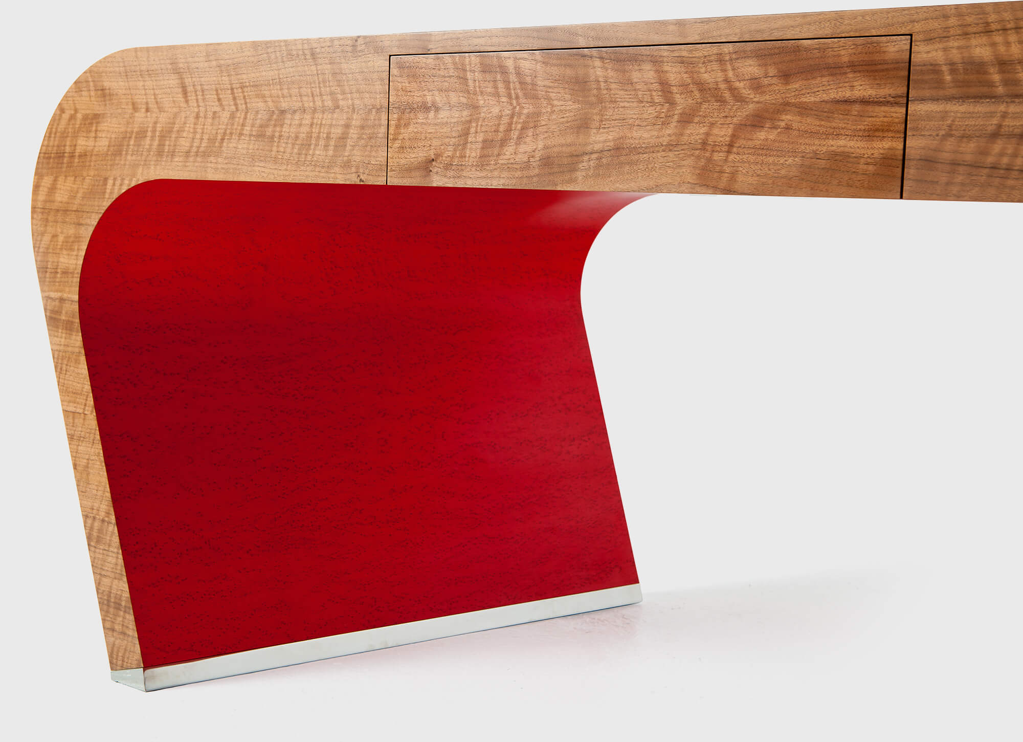 Custom made luxury desk with red and metal detail by Splinterworks