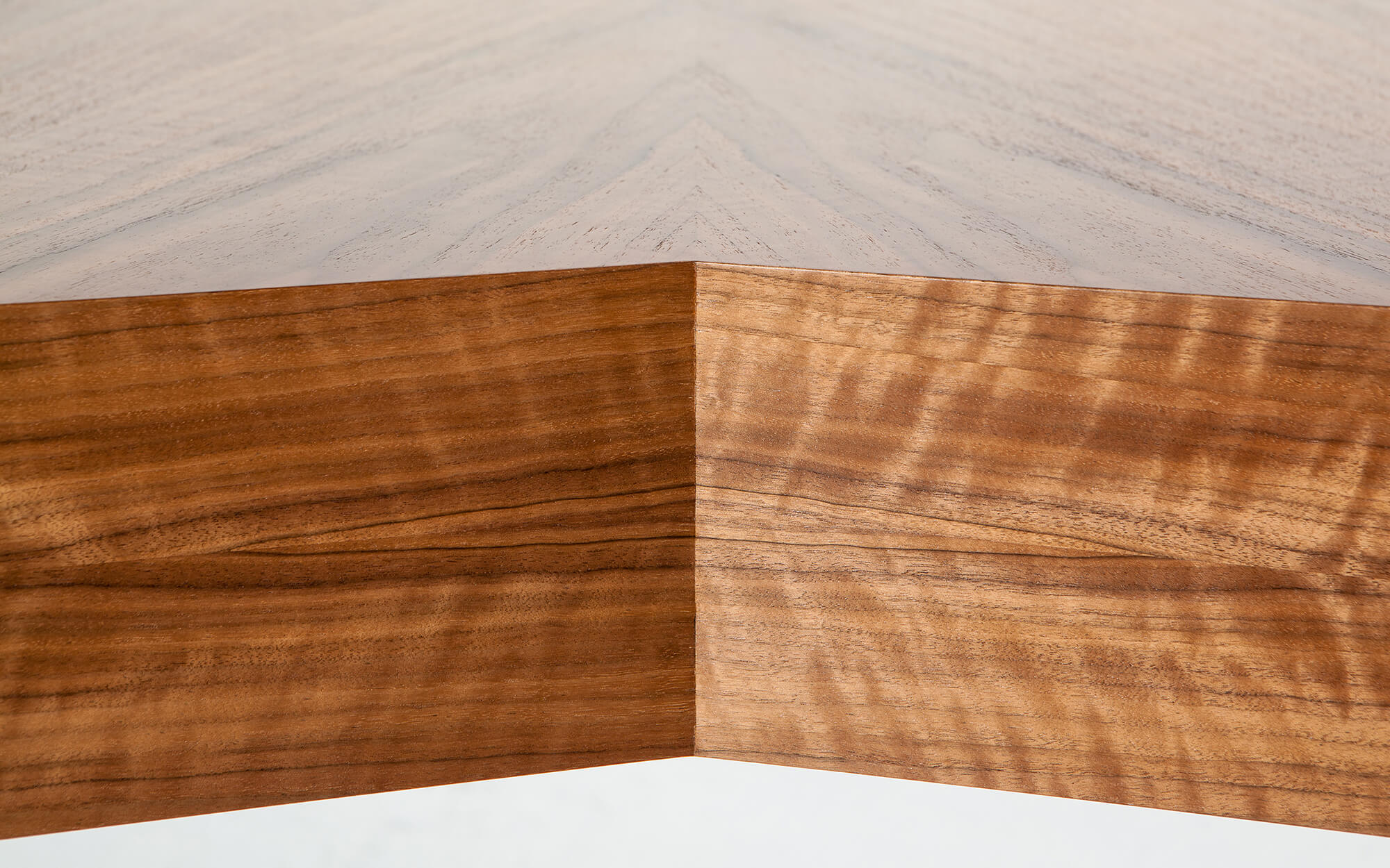 Detail of book matched veneers on custom made v-shaped desk