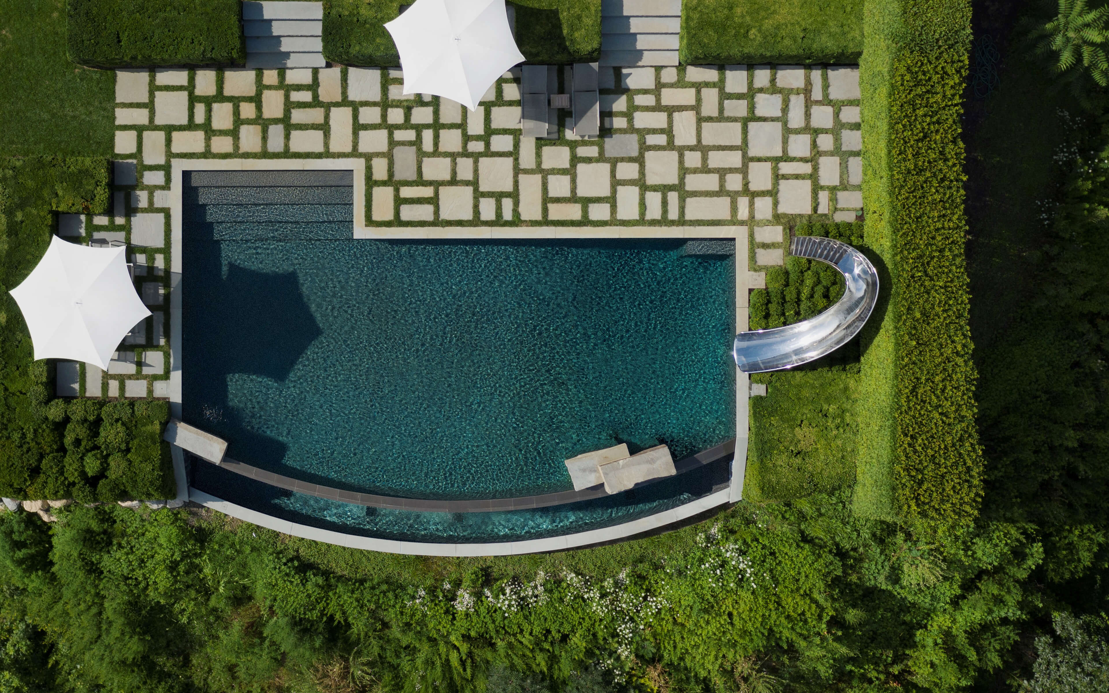 Birds eye view of family pool with pool slide