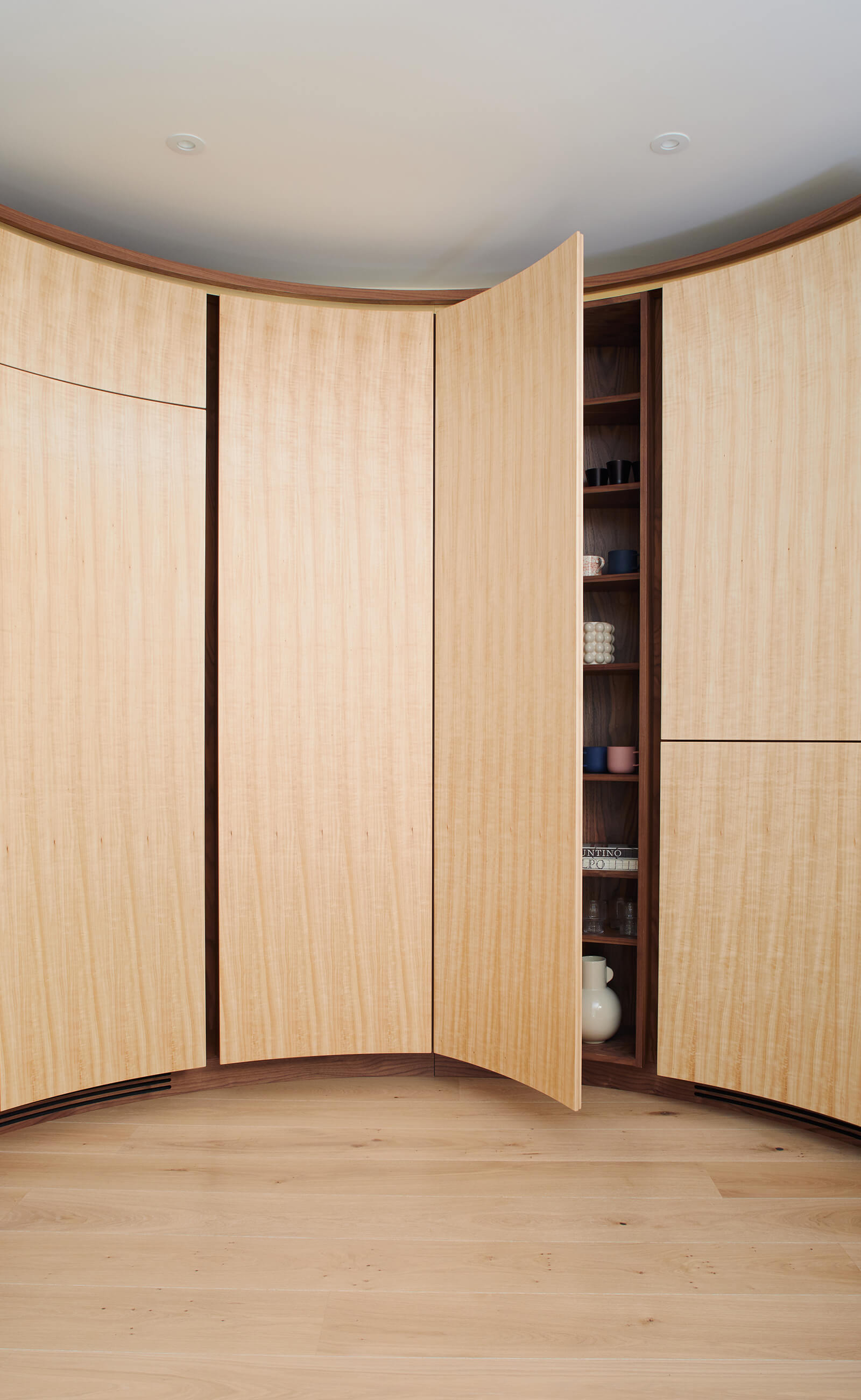 Thoughtful storage in contemporary circular kitchen designed by Splinterworks