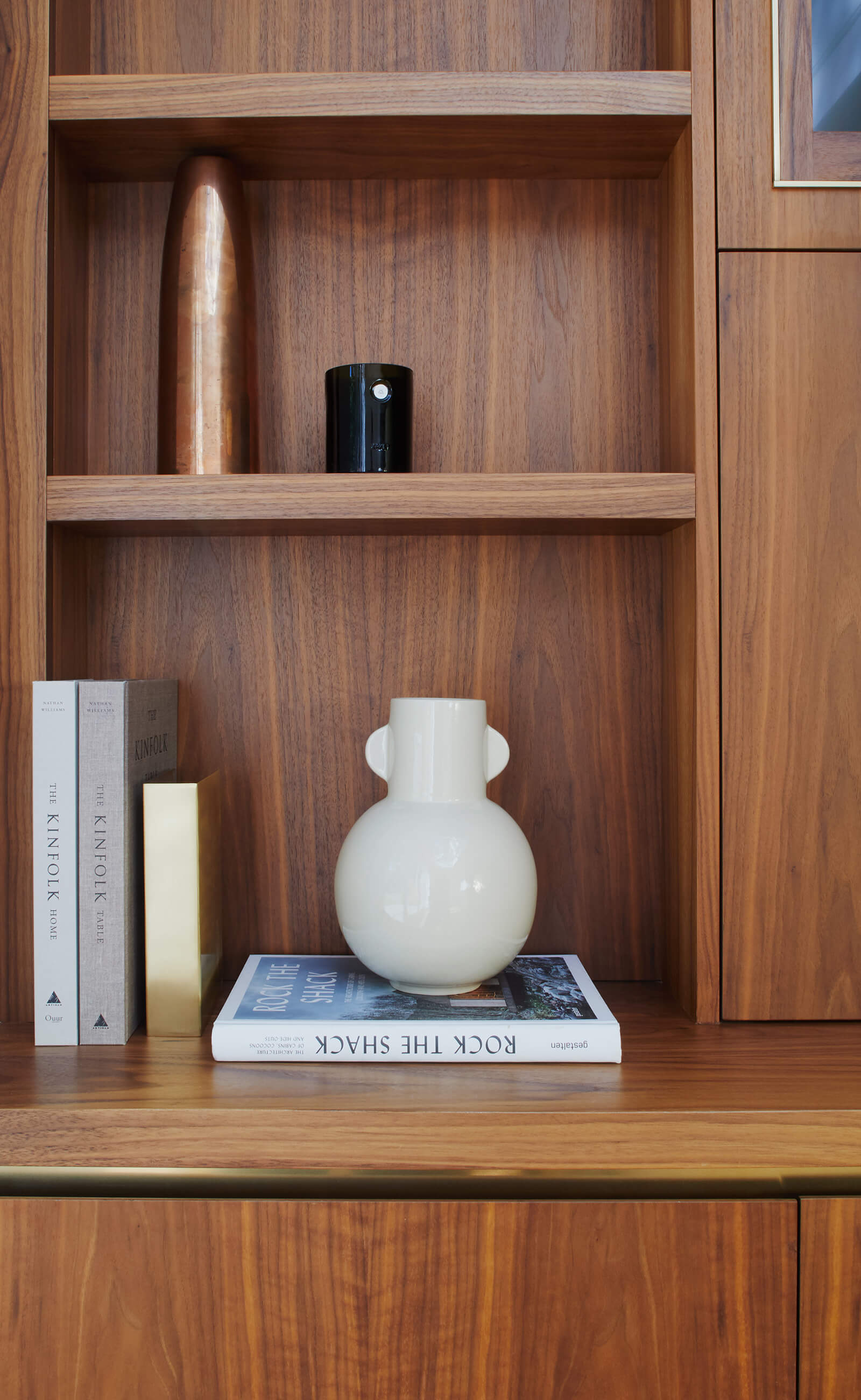 Bespoke walnut cabinetry with brass detail by Splinterworks