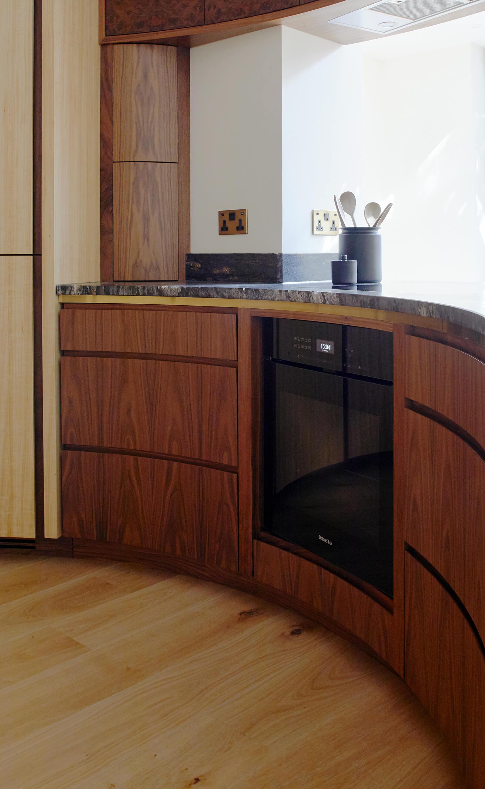clever storage in the curved kitchen design by Splinterworks