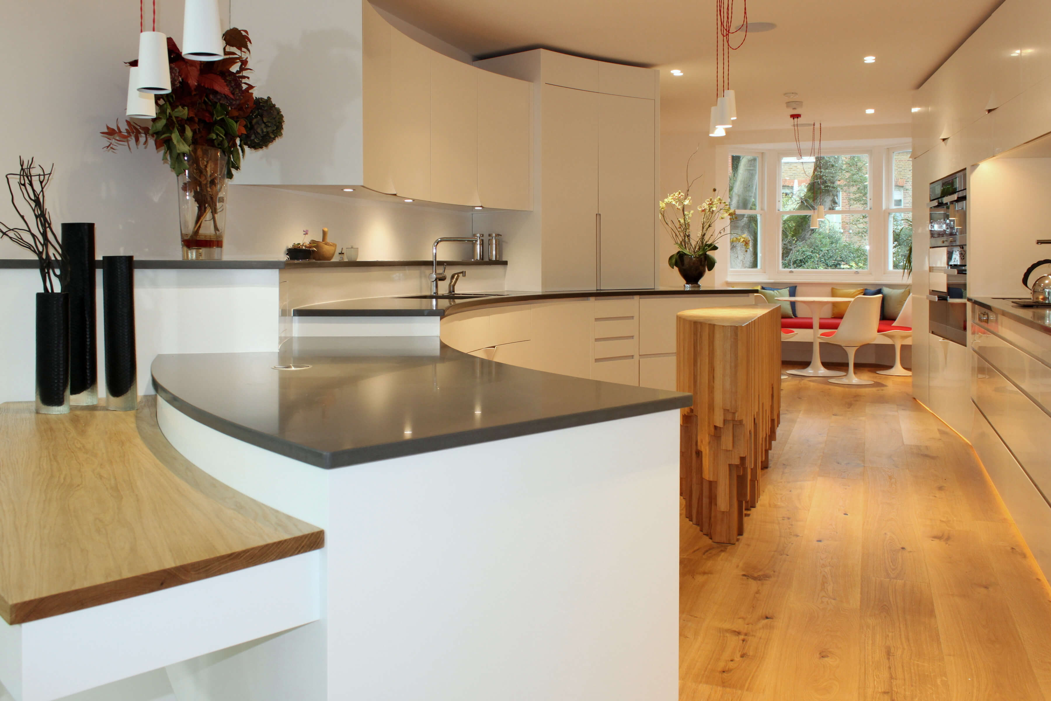 Original design for modern kitchen built over a split level with a sculptural kitchen island