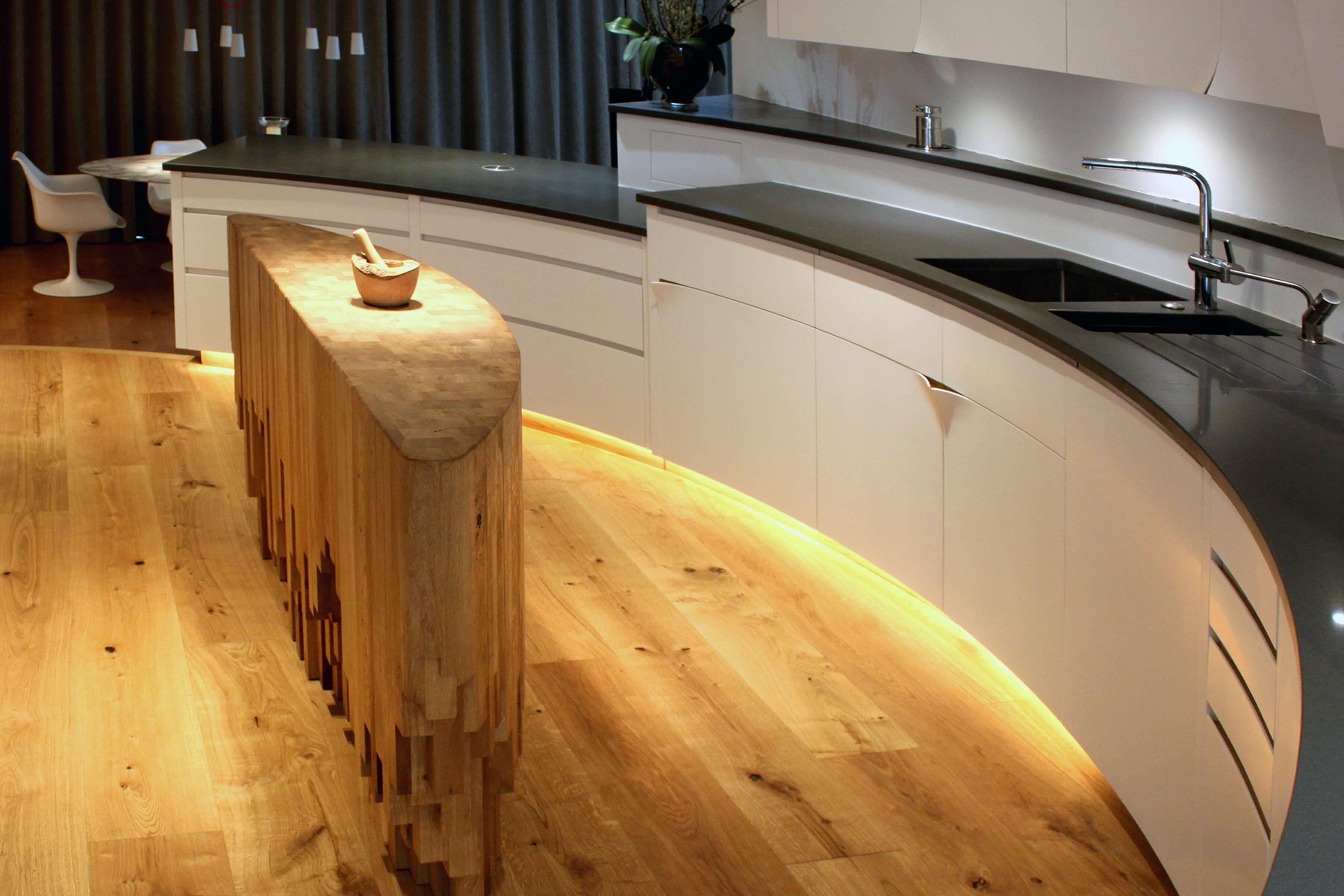 Curved kitchen designed by Splinterworks with a sculptural kitchen island