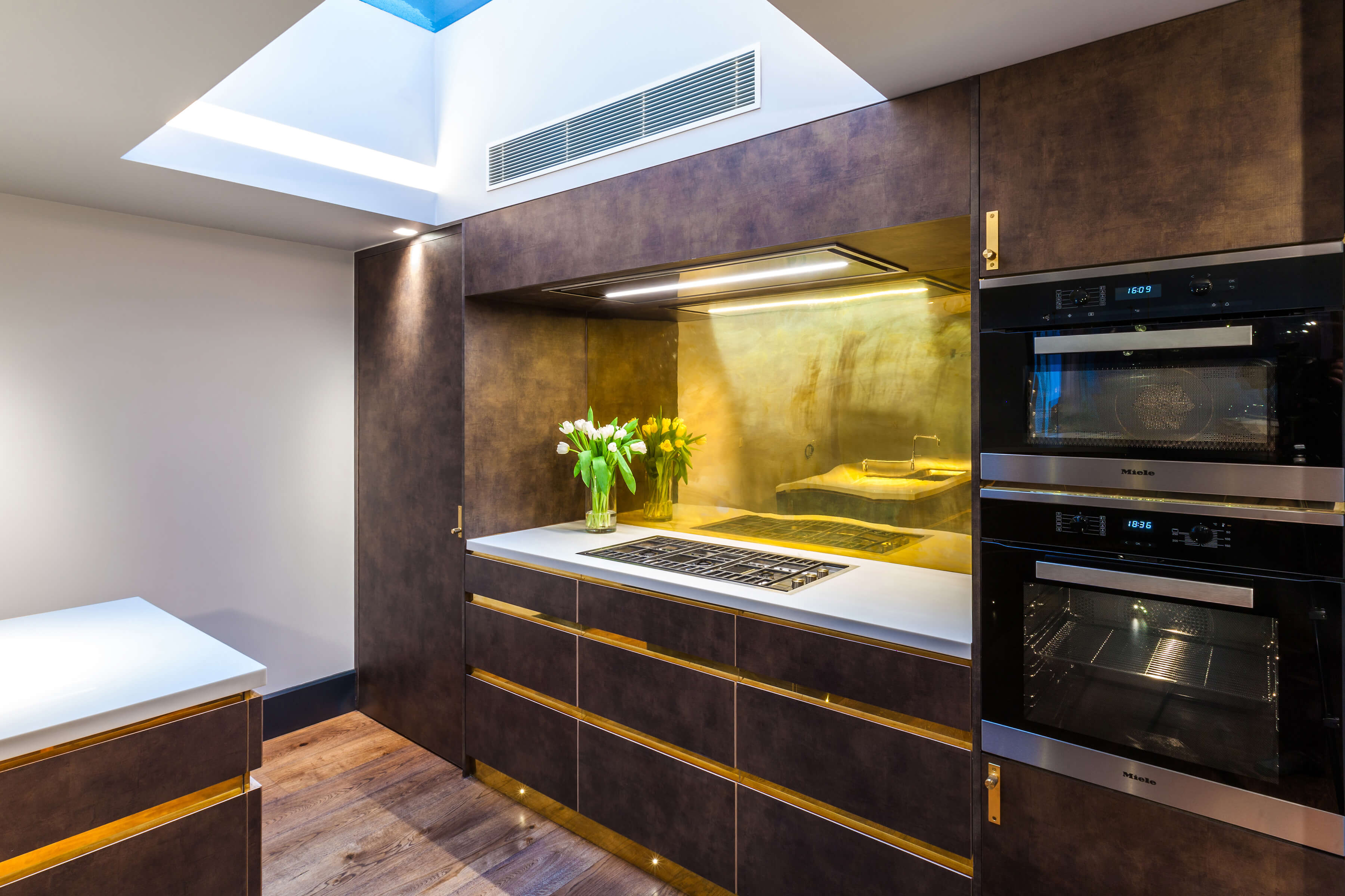 Skylight in luxurious kitchen with tactile cabinets