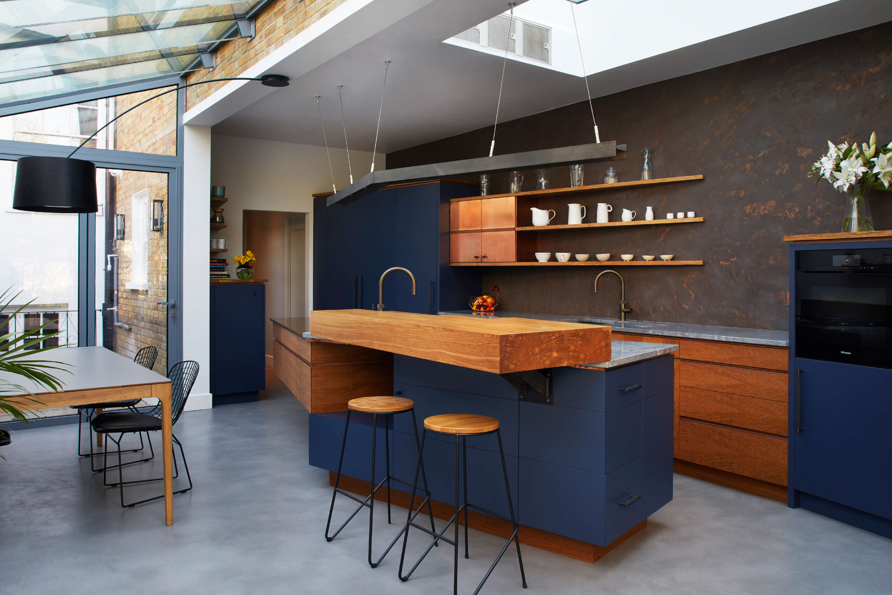 A fun family kitchen in London townhouse designed with copper and concrete details