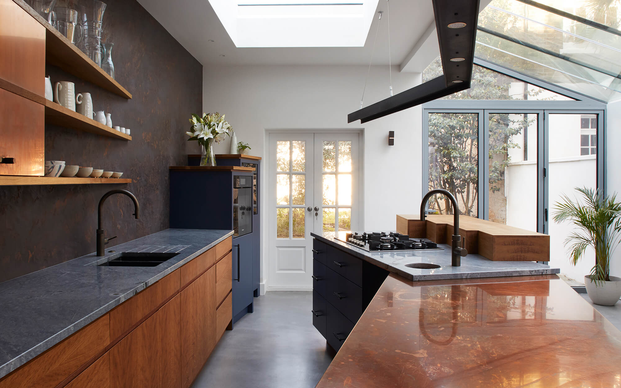 A fun ergonomic kitchen with concrete and copper work surfaces