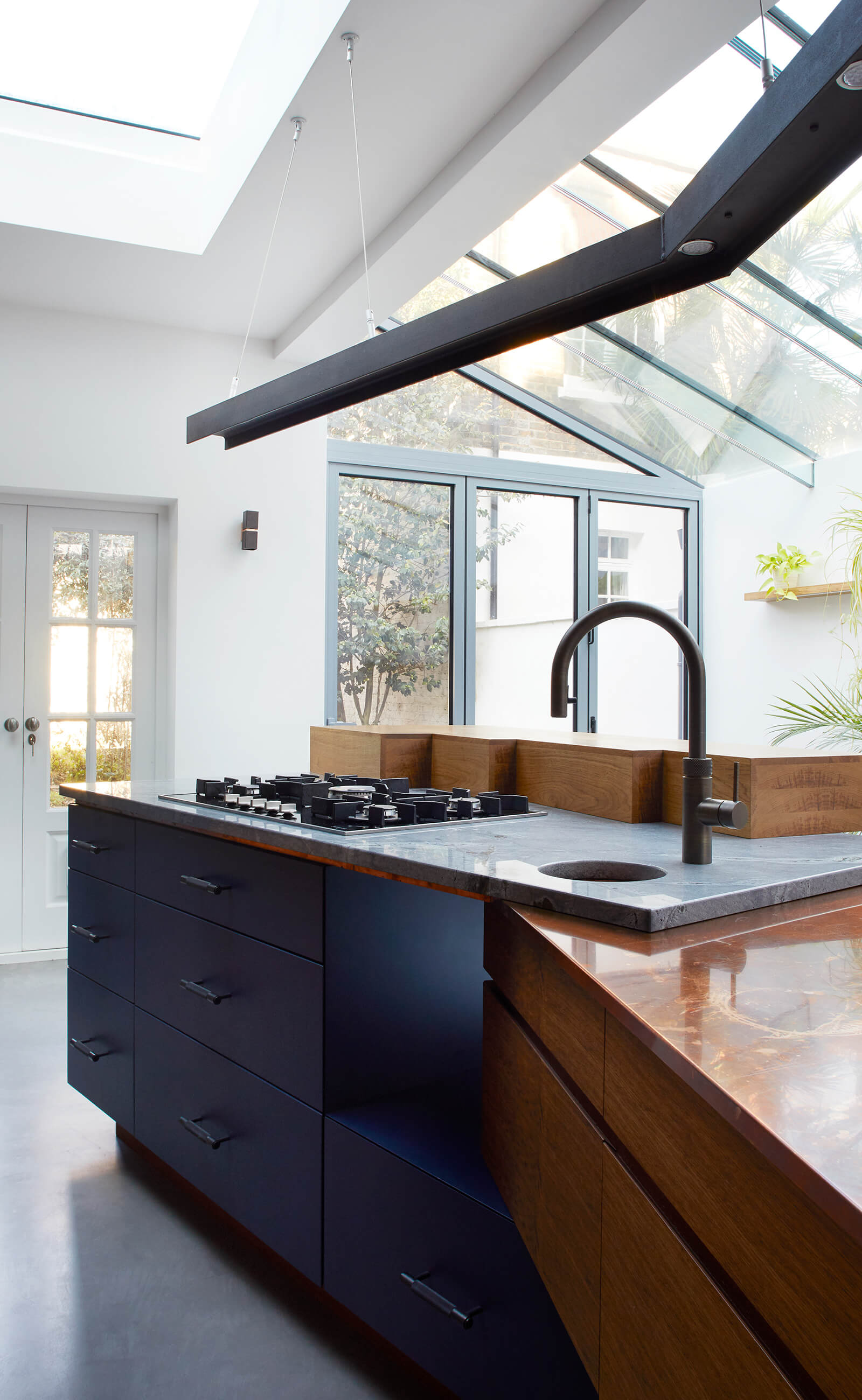 Concrete and copper work surfaces in family townhouse kitchen designed by Splinterworks