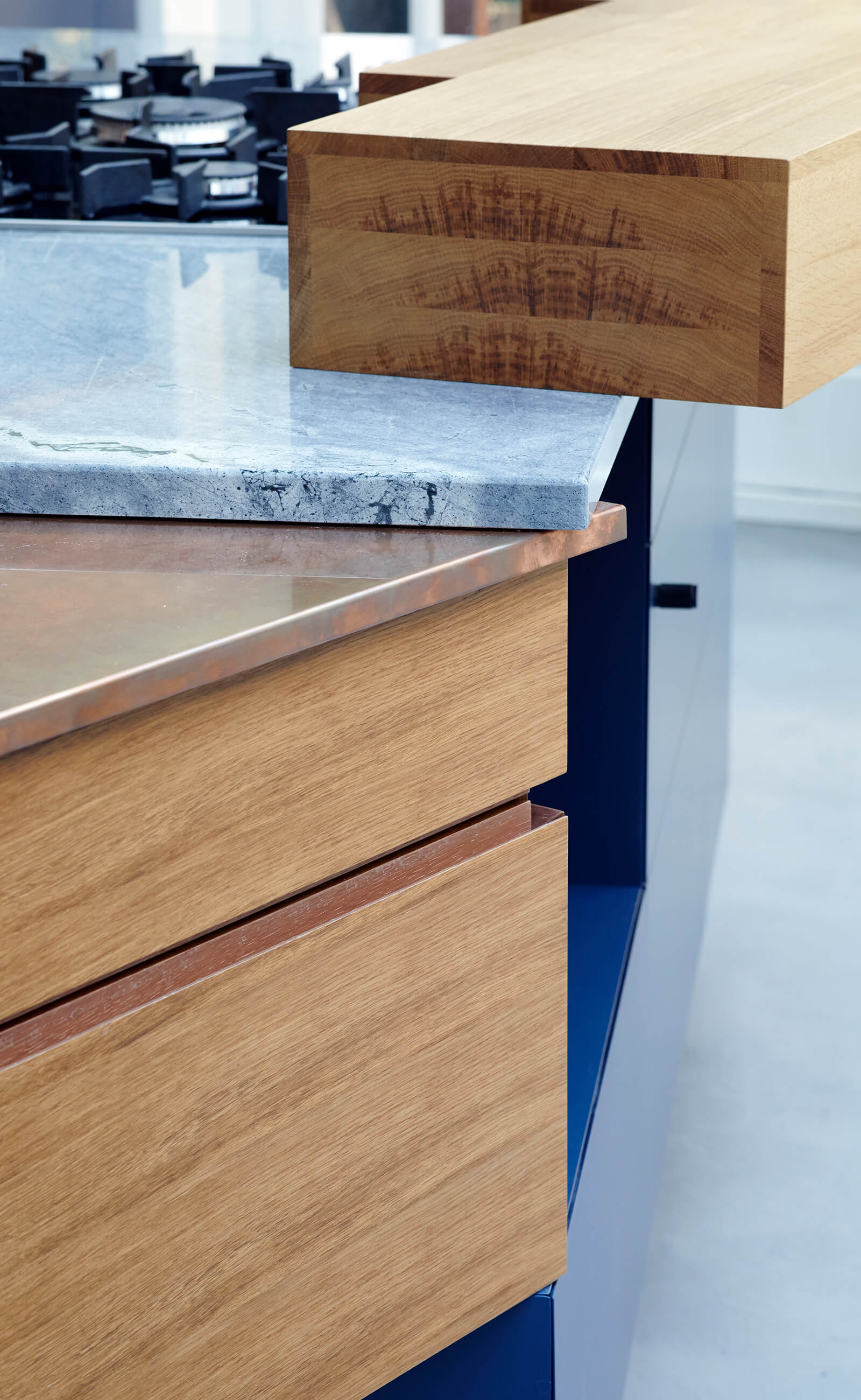 Counter top details in marble and copper with clever storage below