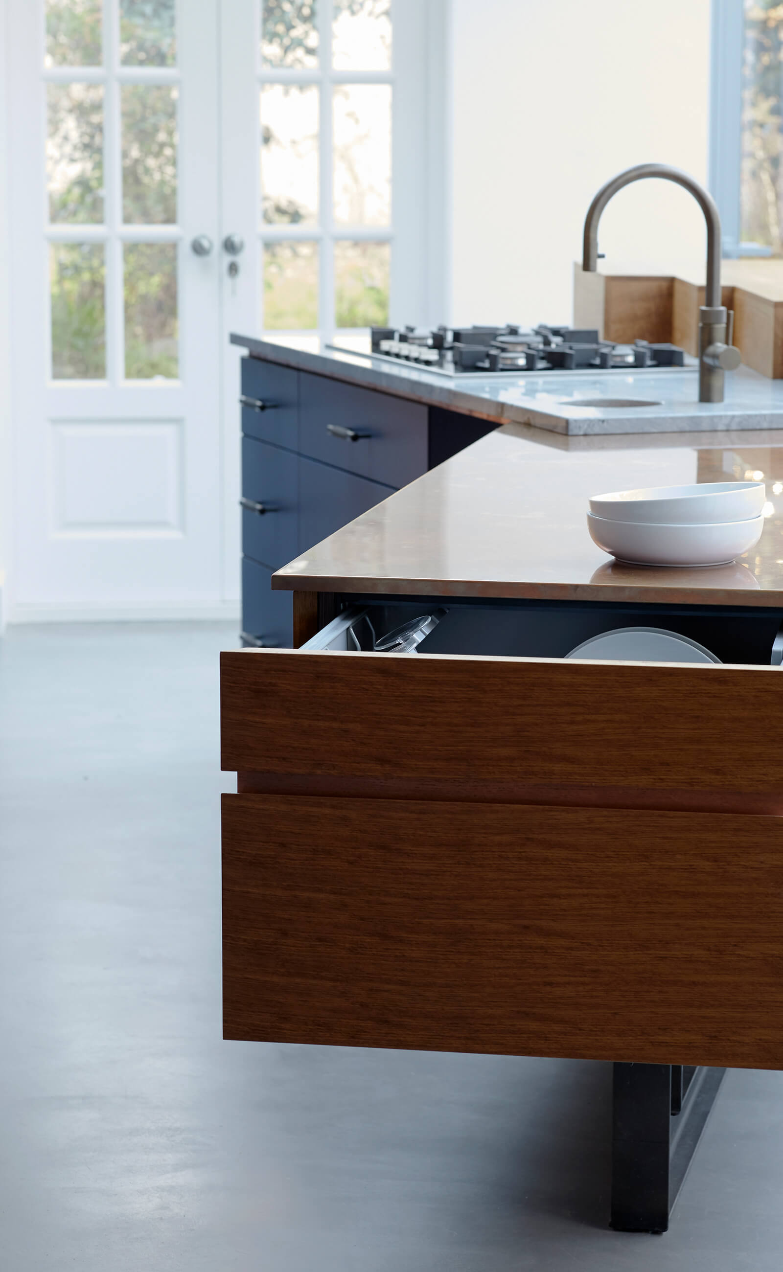 Clever dishwasher drawer storage in fun family kitchen