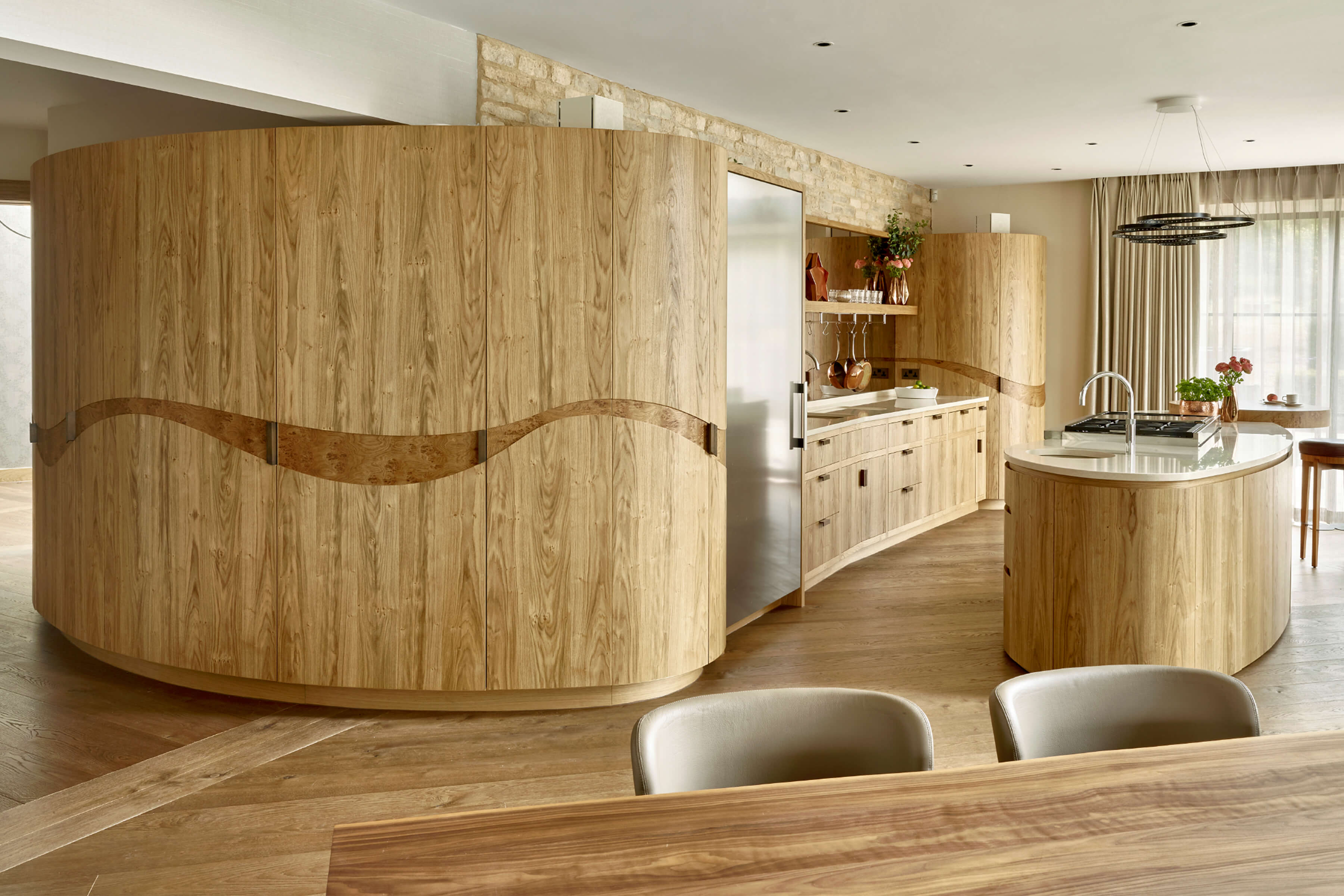 contemporary oak kitchen with organic shaped kitchen island
