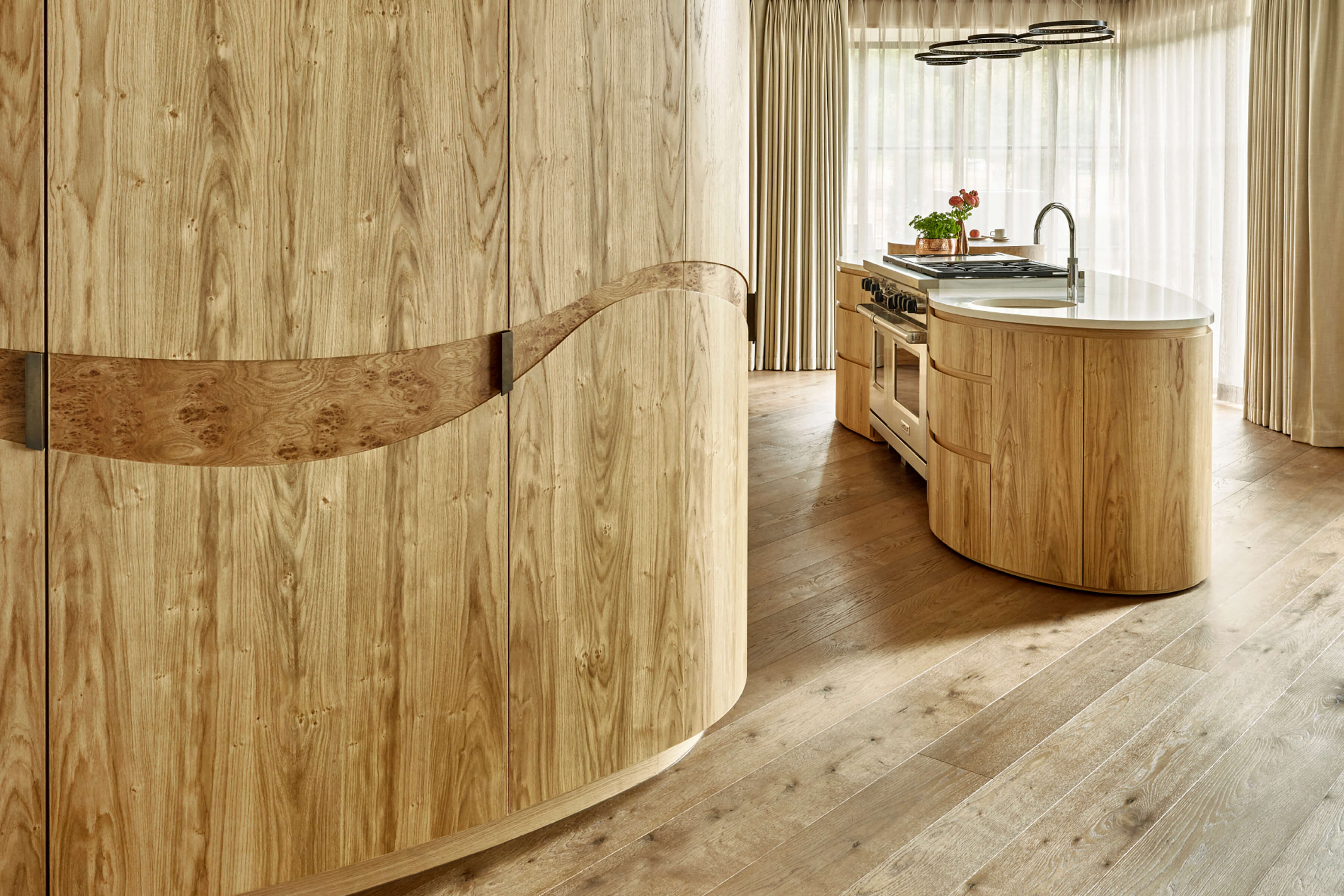 Custom made curved kitchen cabinetry in natural woods