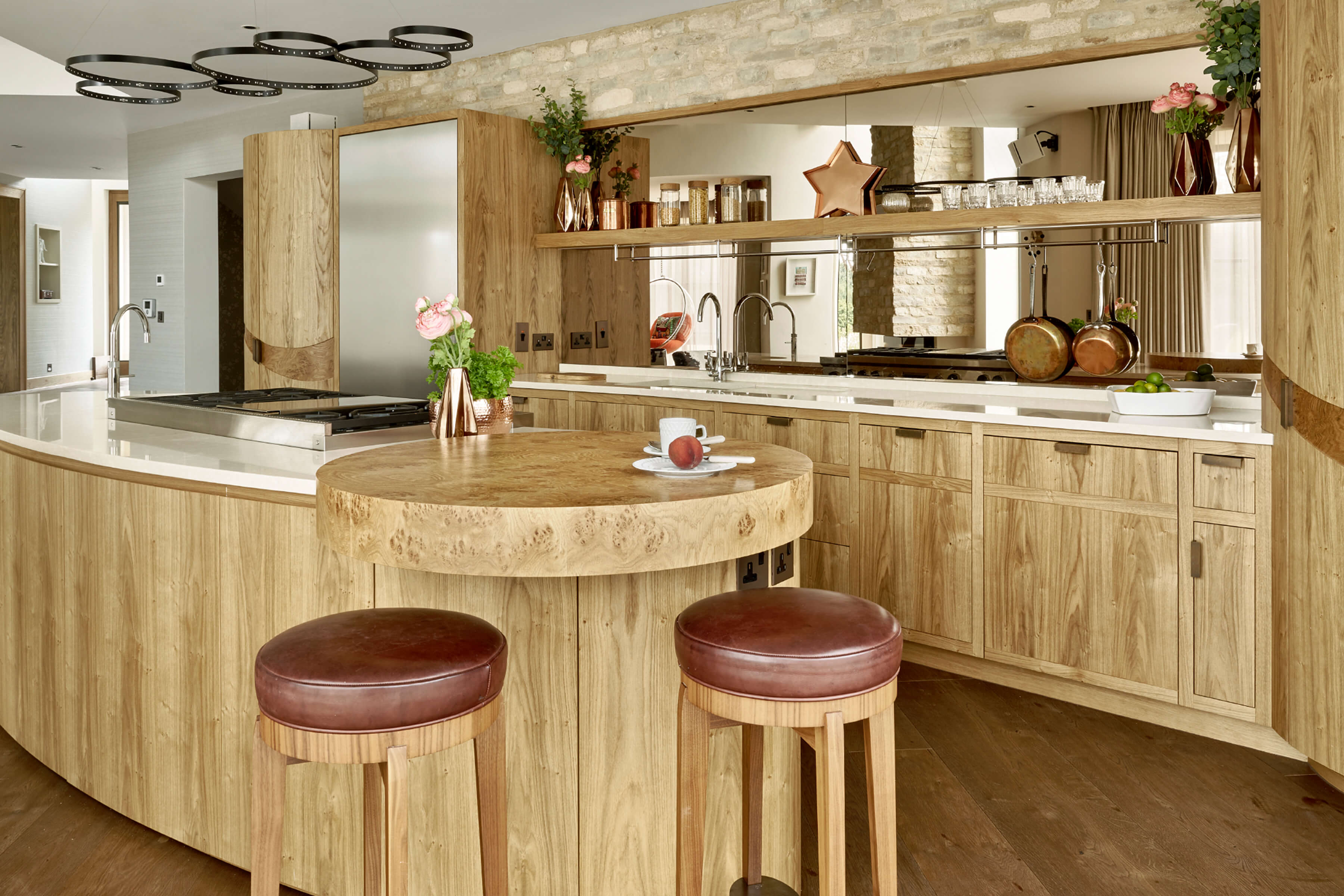 Contemporary oak kitchen with curved cabinetry by Splinterworks