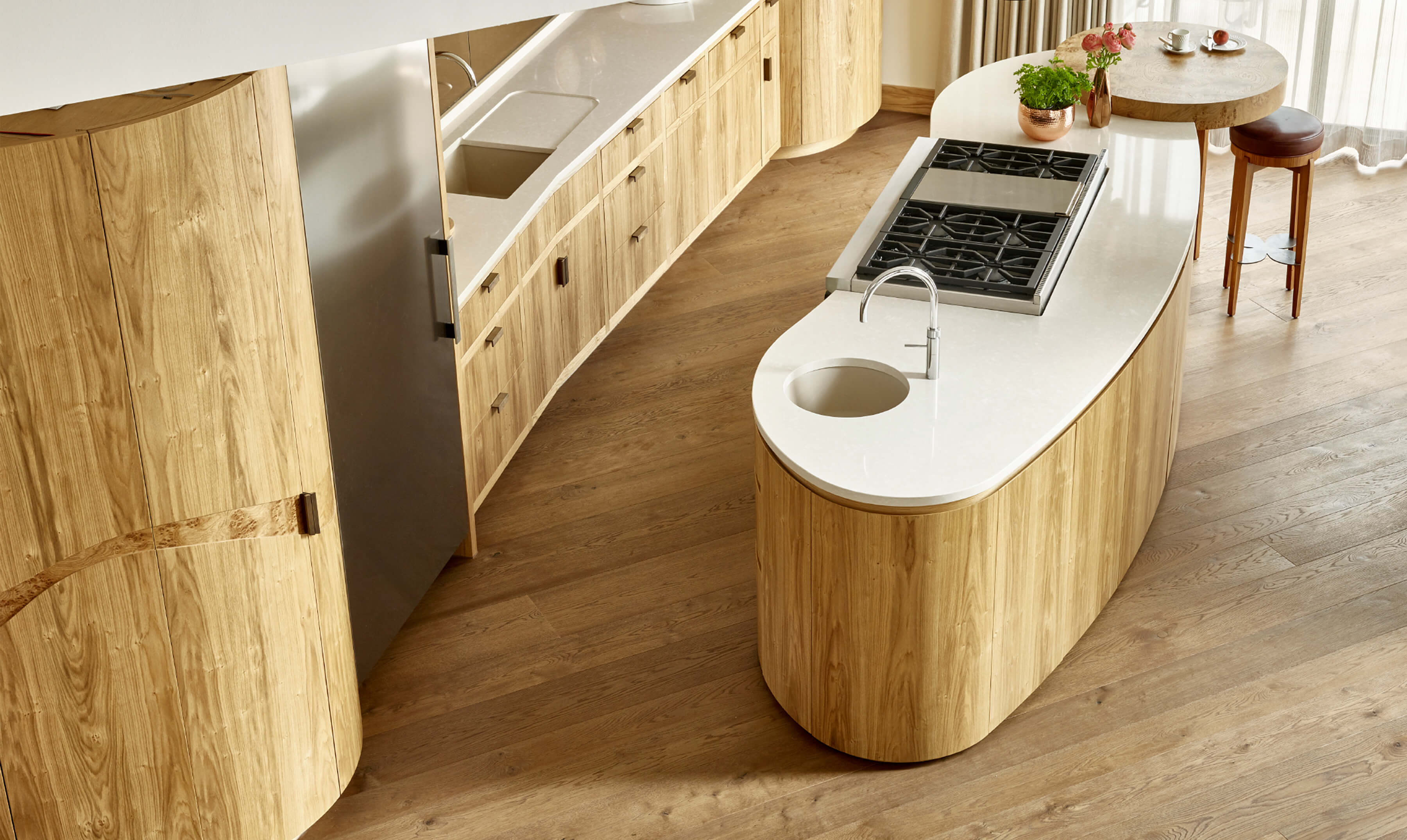 View of oak kitchen from above, with organic shaped kitchen island