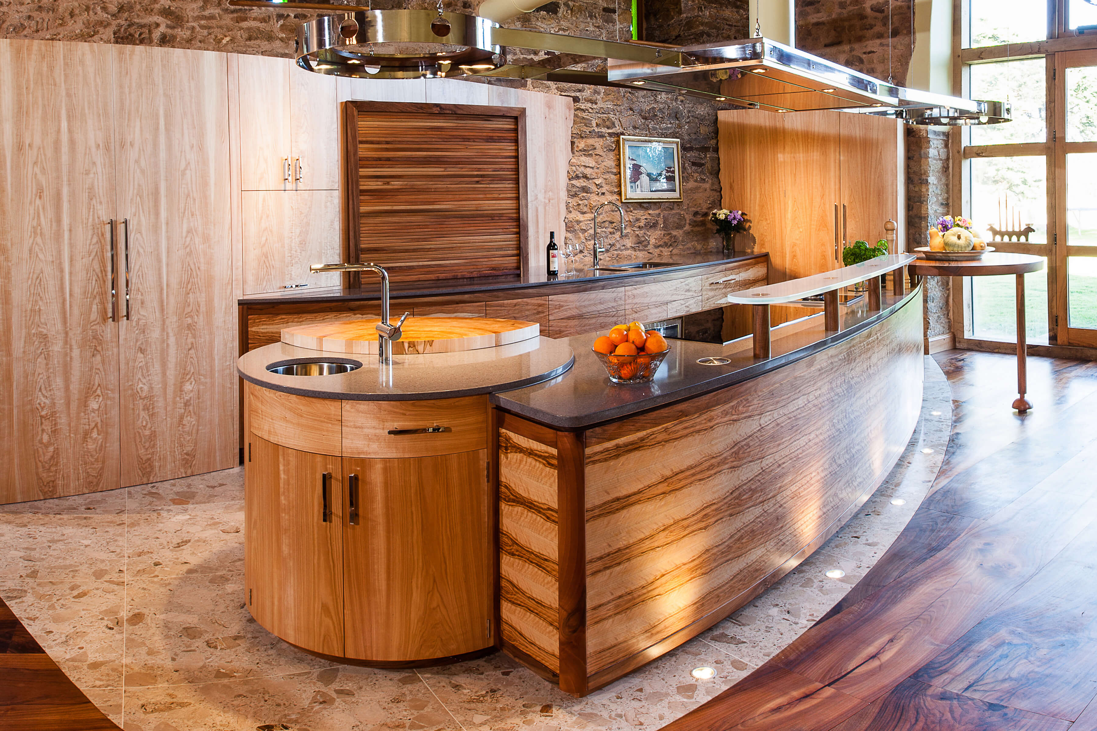 Curved kitchen design for barn restoration by Splinterworks