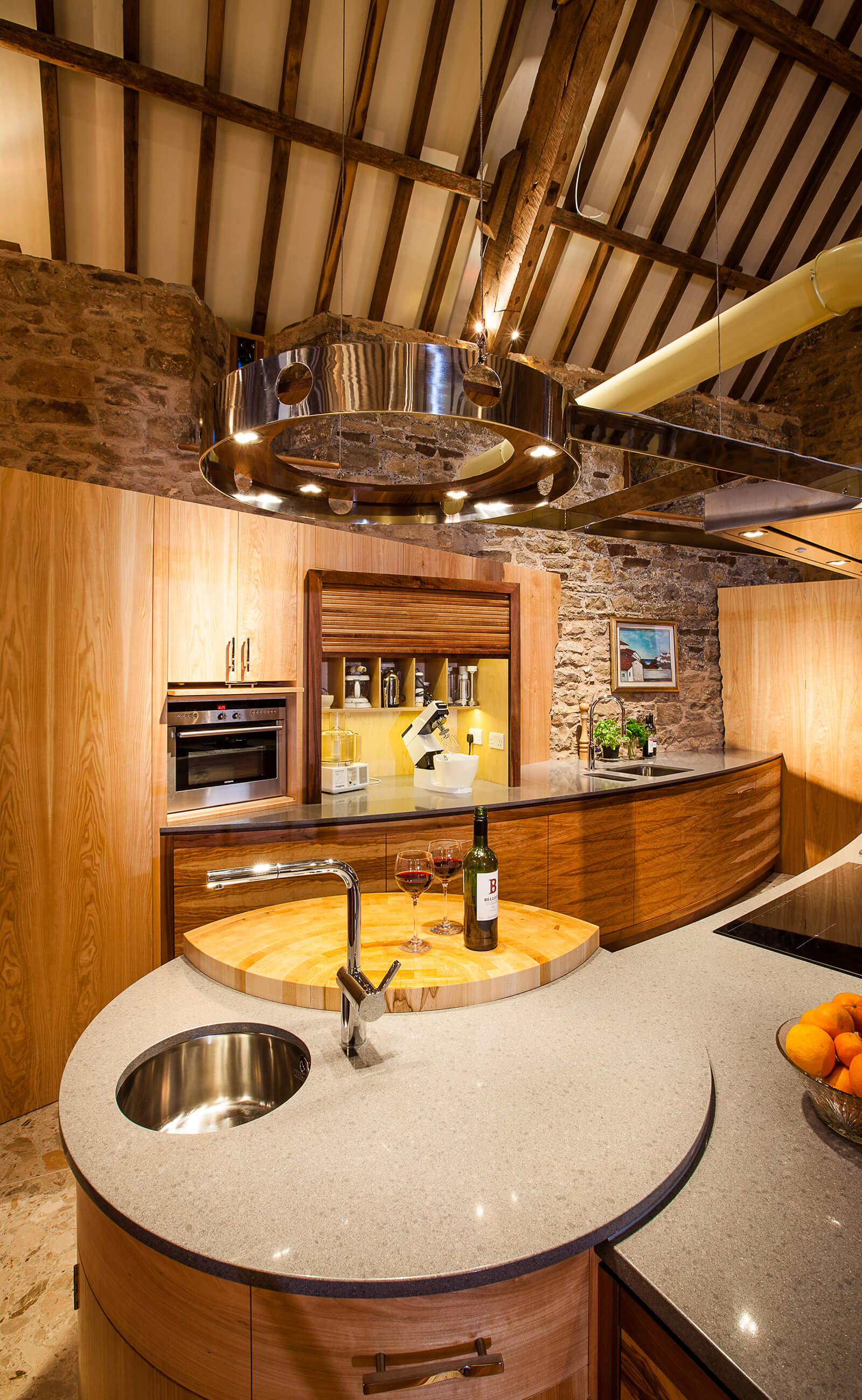 Curved kitchen design in barn restoration