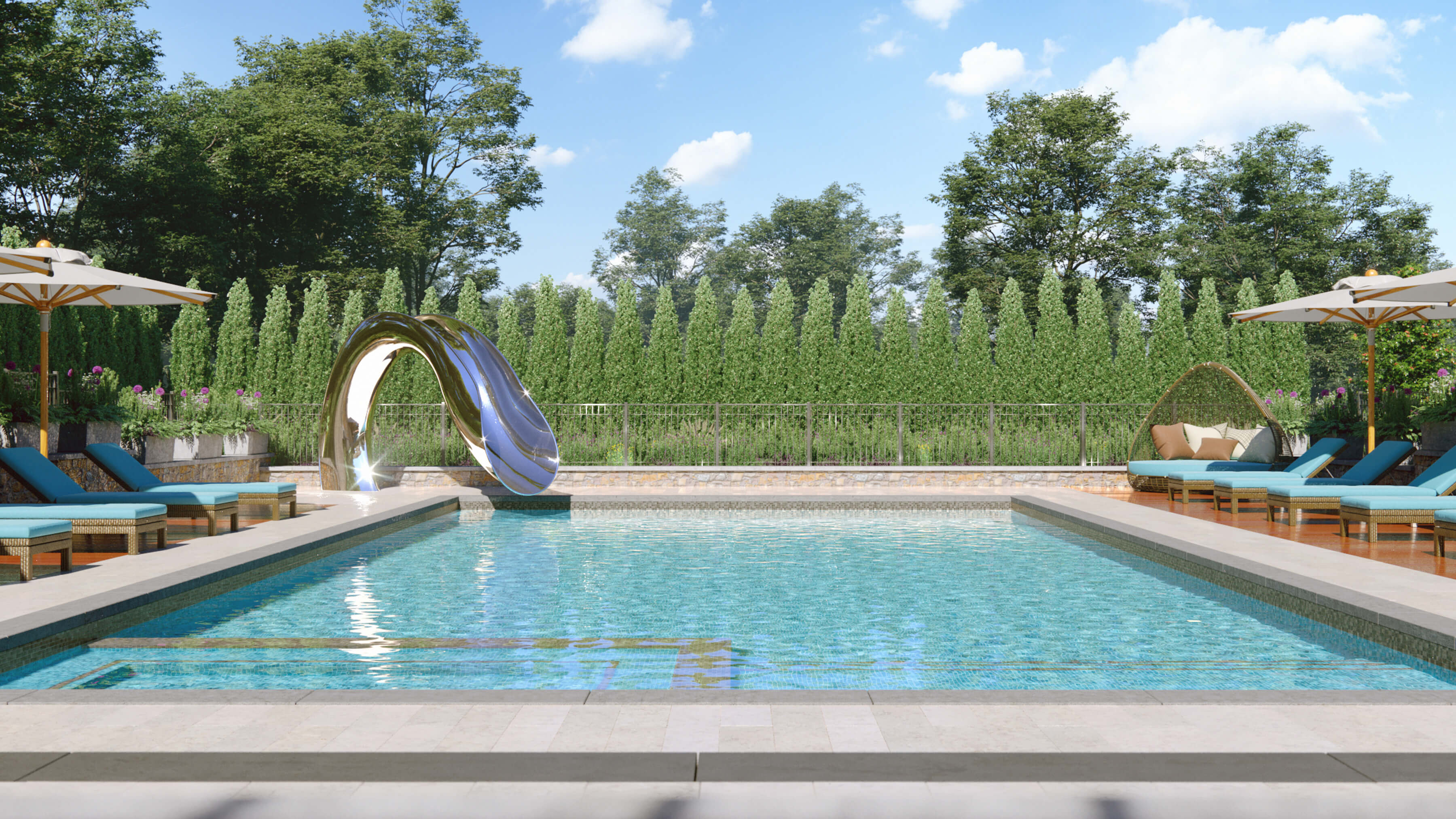 Custom water slide designed by Splinterworks next to pool with blue loungers.