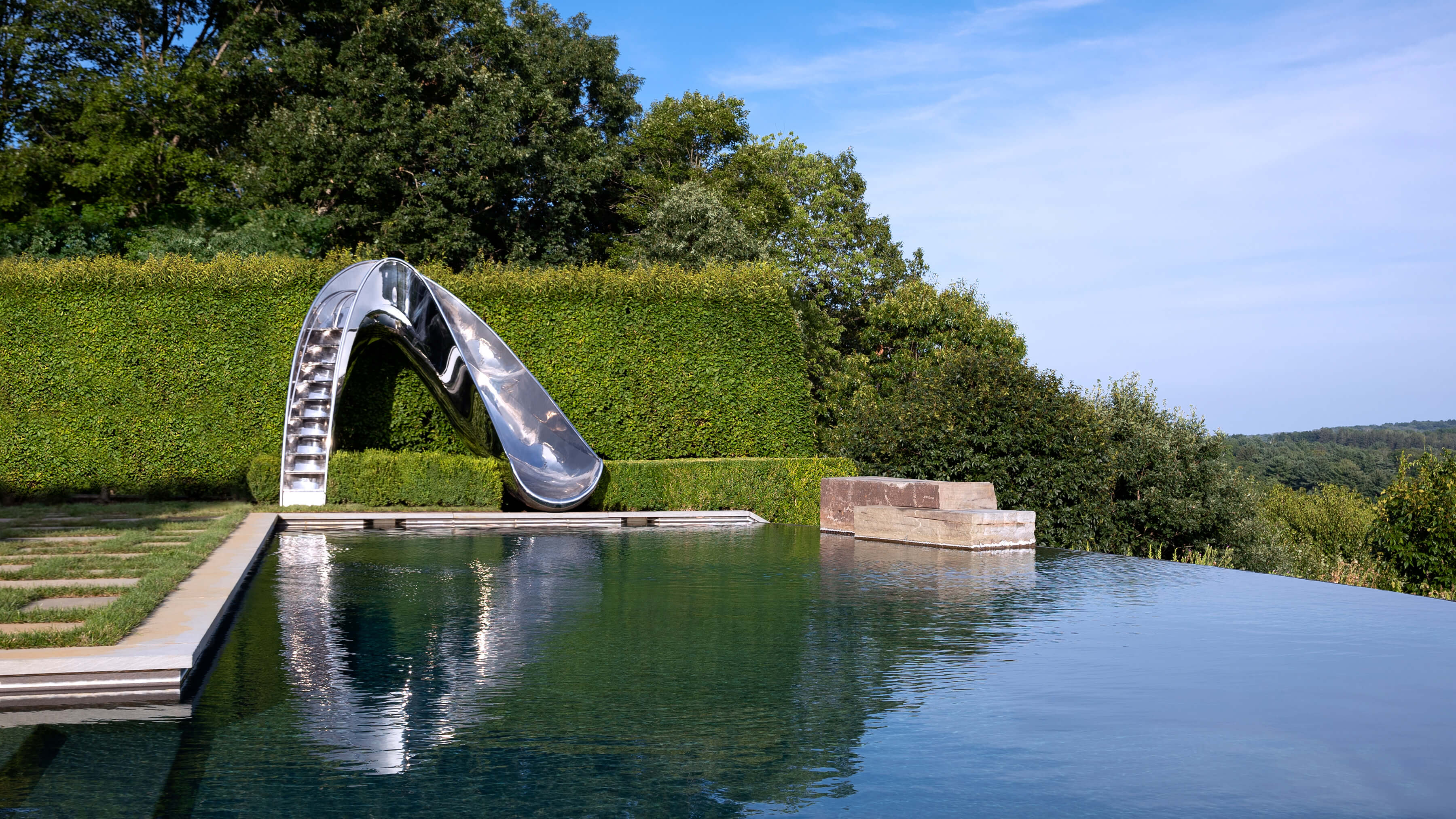 Luxury metal water slide built to US and EU safety standards.