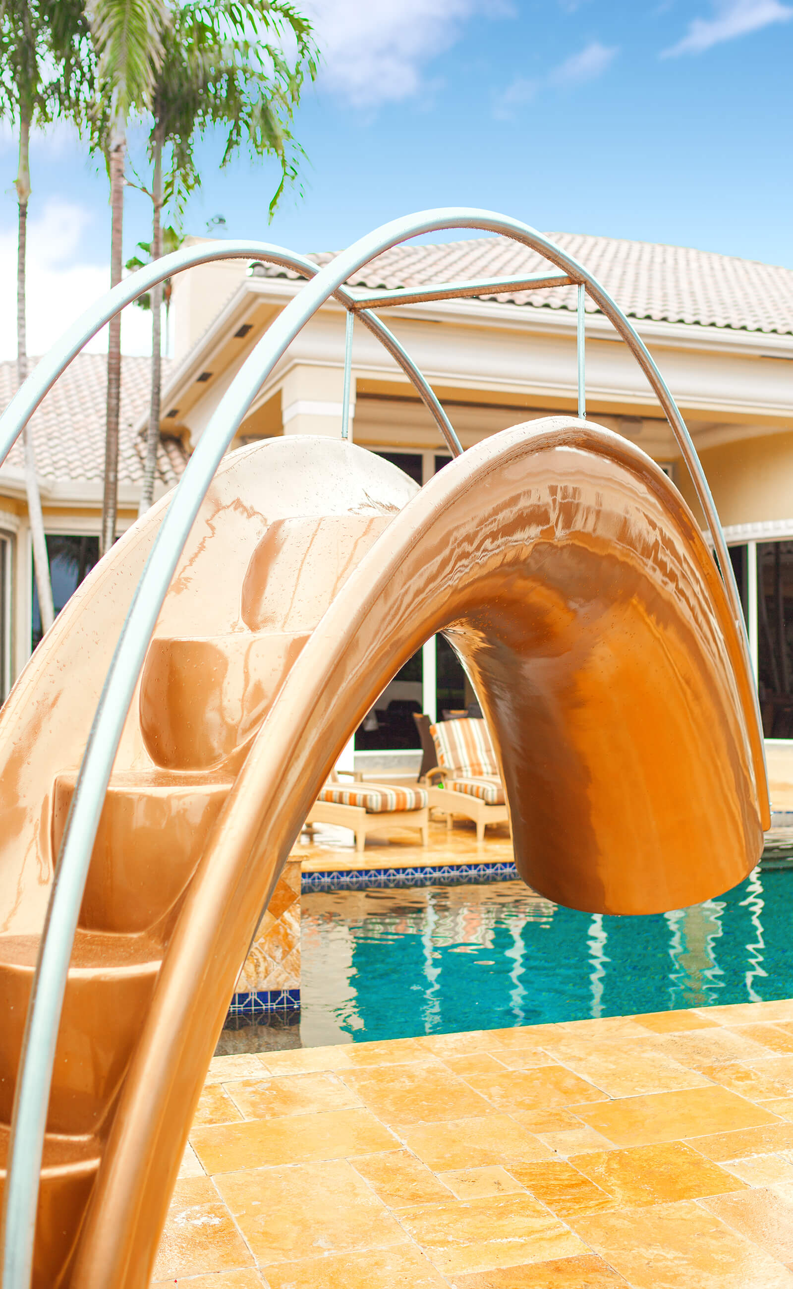 Integrated steps and handrails on outdoor family water slide by Splinterworks