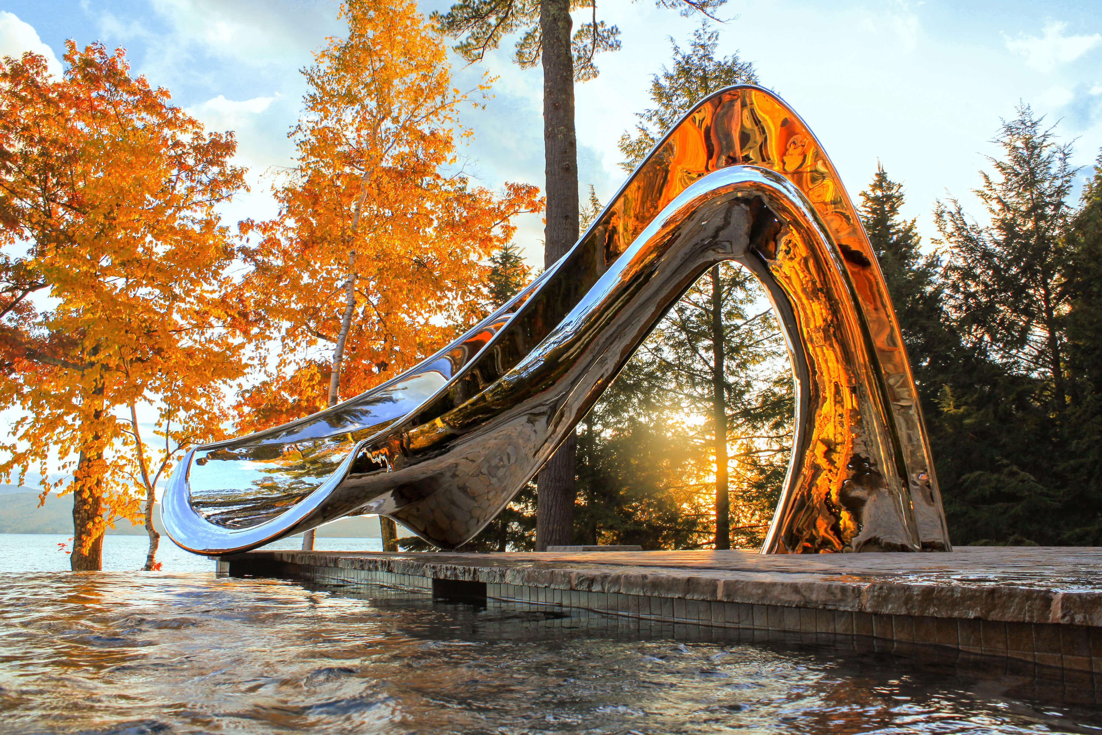 Vertex pool slide beside lake in fall