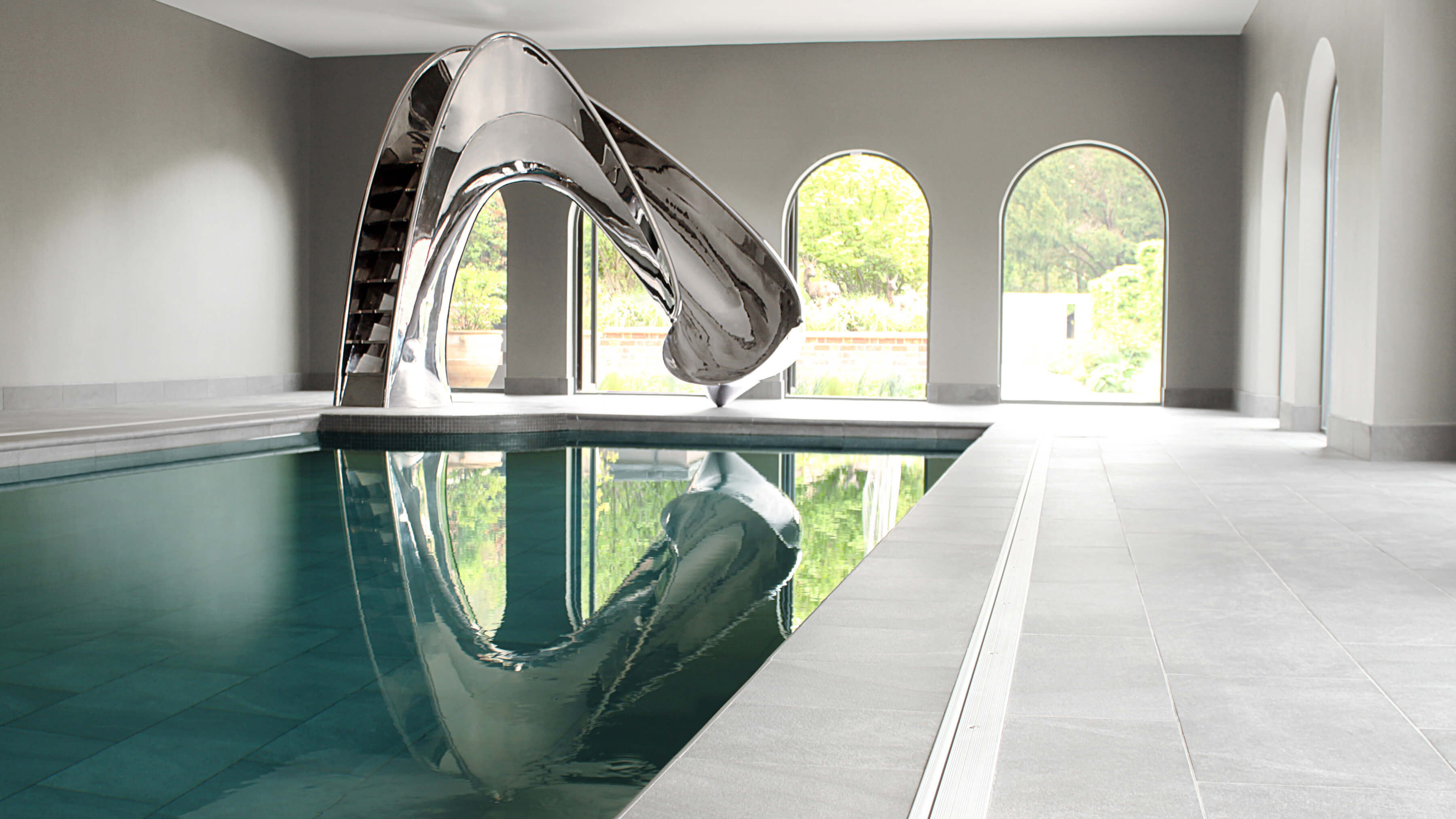 Dramatic sculptural pool slide by Splinterworks in an architectural pool pavillion.