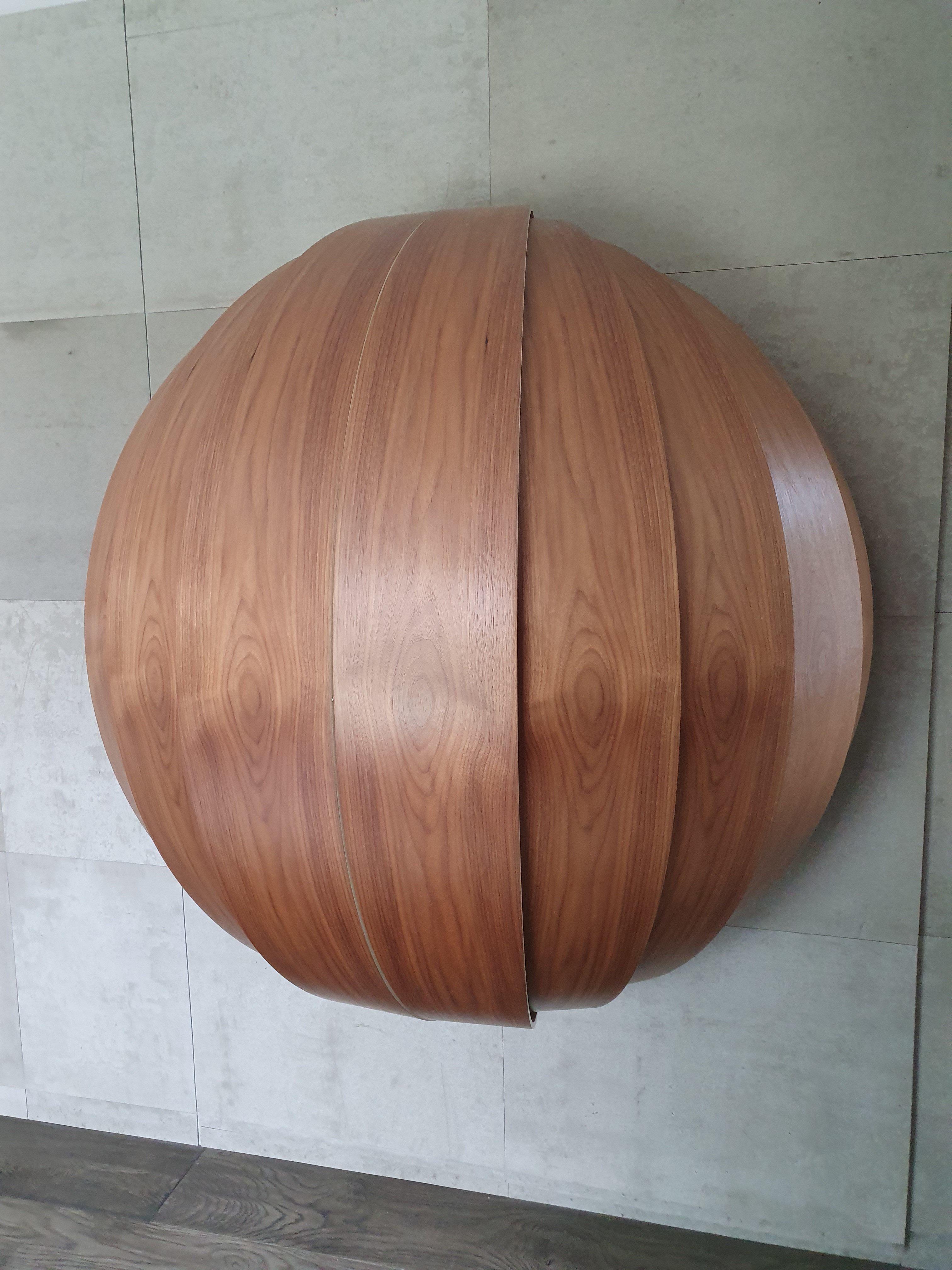Luxury wall-mounted desk with walnut veneer finish by Splinterworks.