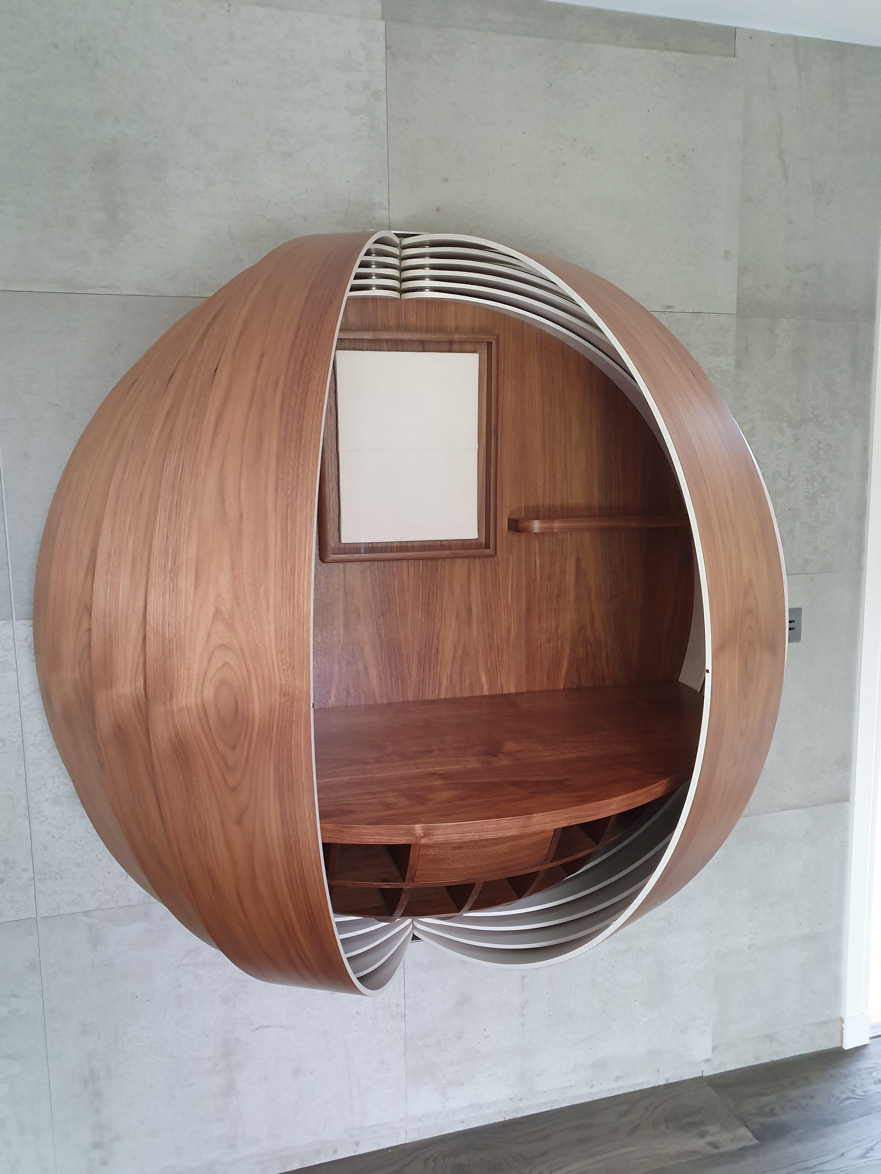 Bespoke wall-mounted desk in walnut by Splinterworks.