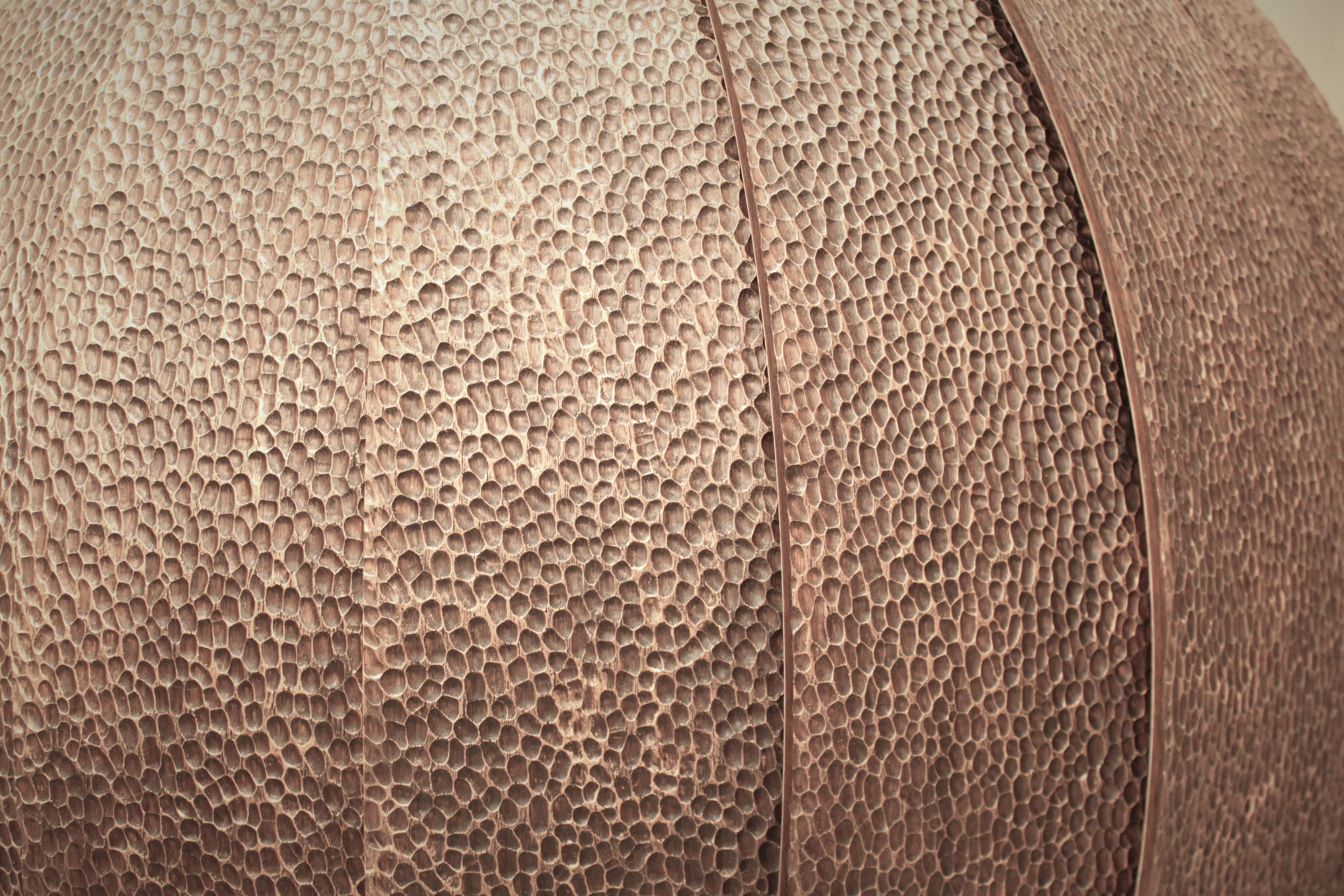 Detail of tooled walnut veneer on custom wall-mounted desk by Splinterworks.