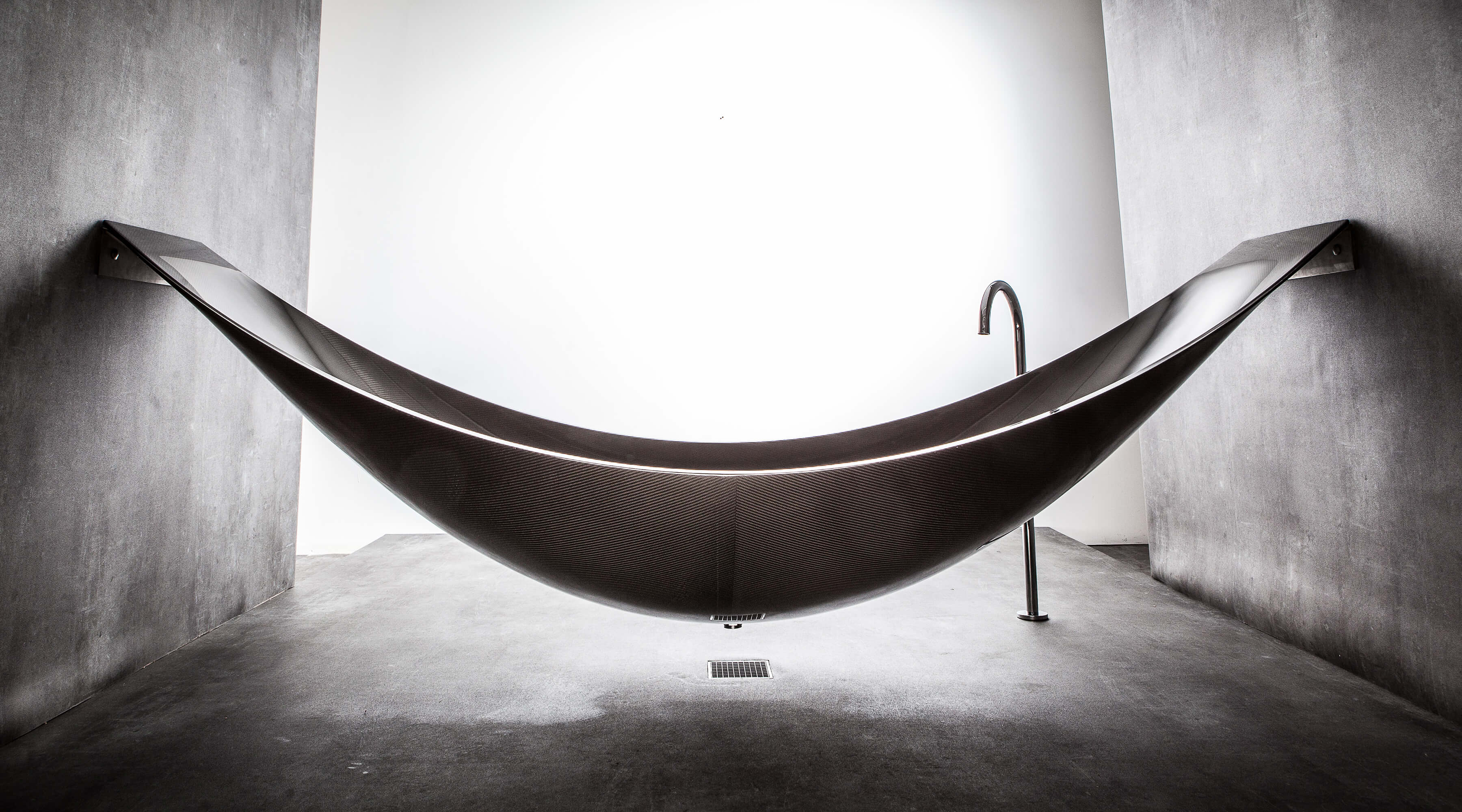 The hammock bath tub manufactured by Splinterworks custom made in black carbon fiber