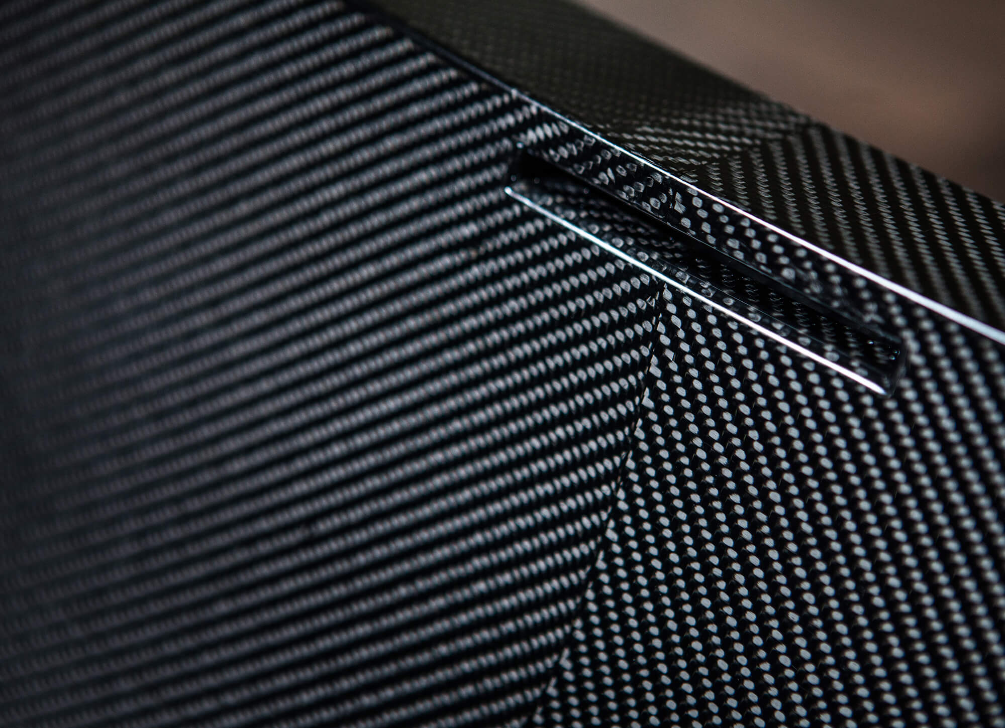 Close up detail of black carbon fibre bath tub.