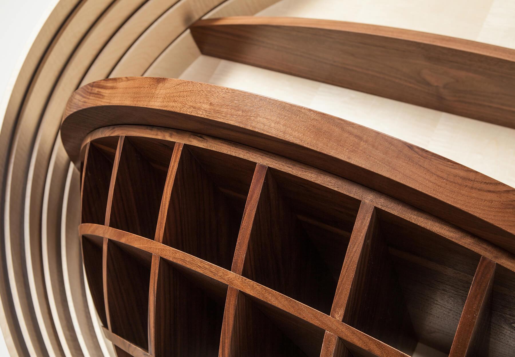 Custom wall-mounted wine wrack in walnut by Splinterworks.
