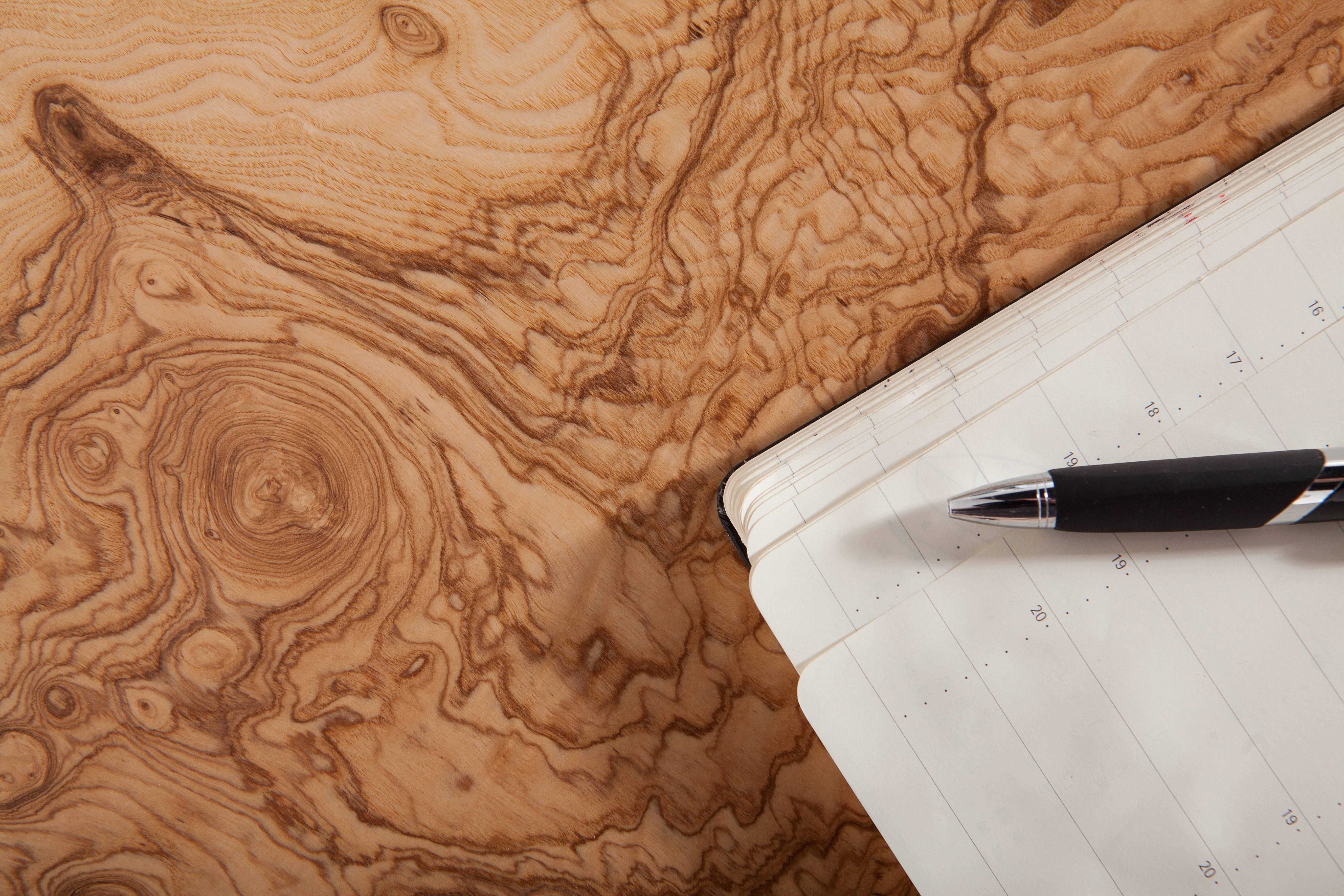 Exquisite unpolished veneer with fountain pen and diary for our bespoke furniture commissions